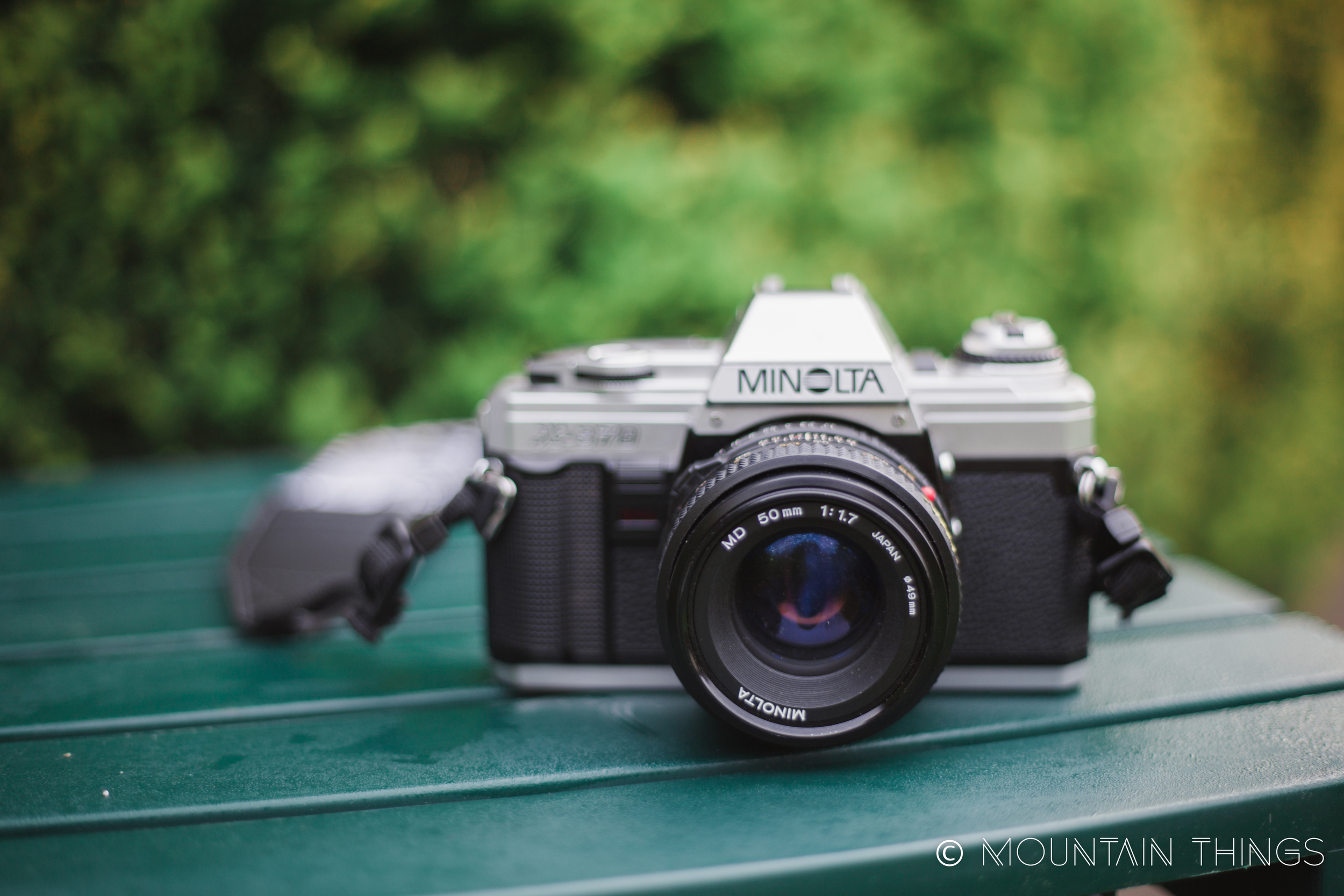 35mm minolta x-370 with 50mm 1.7 lens. lots of dust in the lens but otherwise great shape.