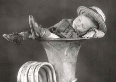 boy-sleeping-in-tuba-art-print-poster.jpg