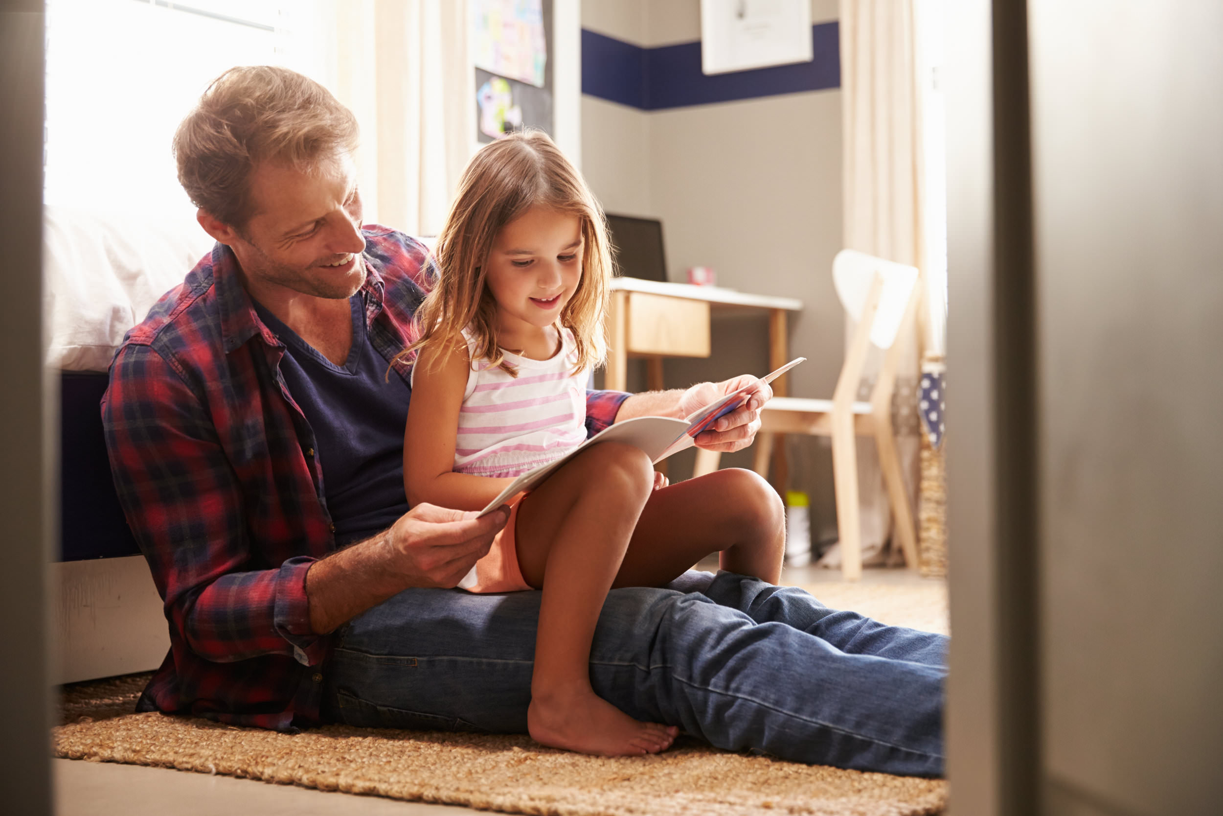 Father and daughter reading book.jpg