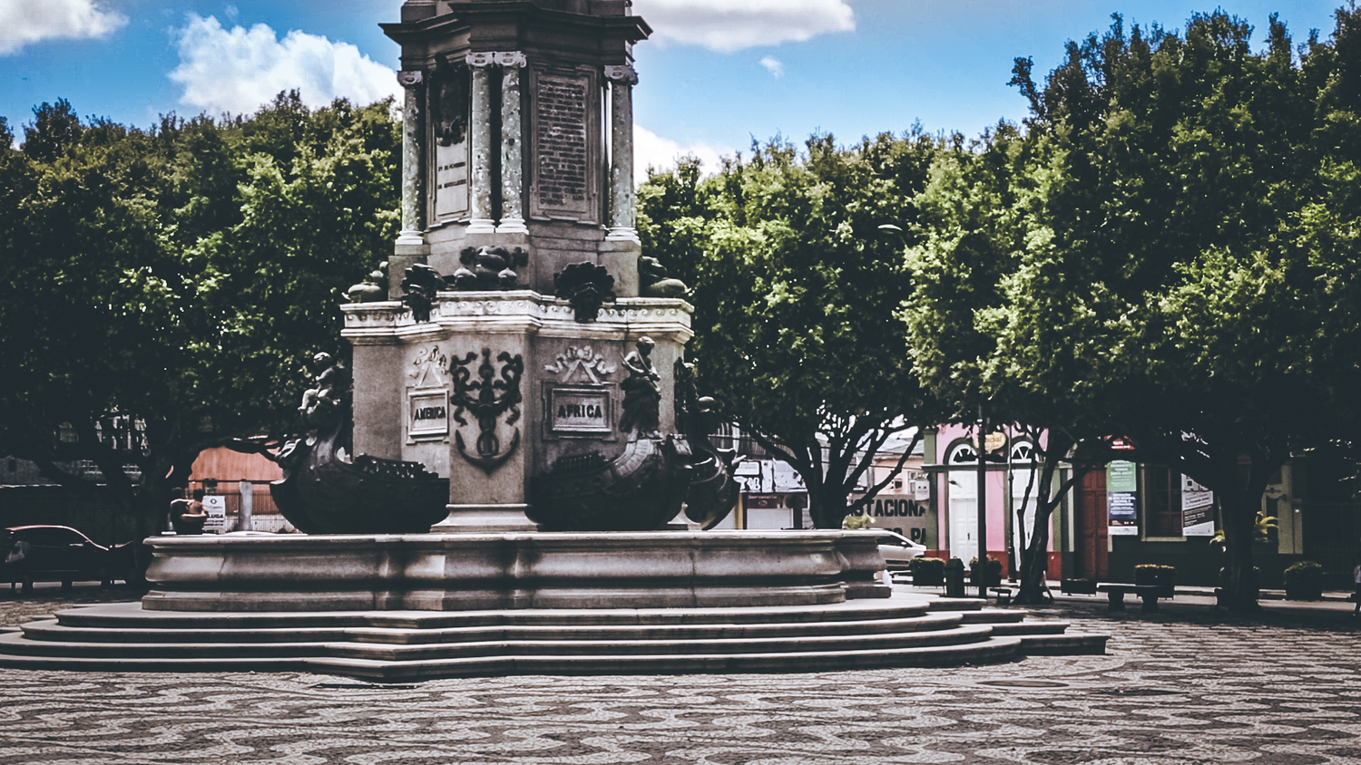 A city park with a fountain that talks about the imported goods used to build the Amazon Theatre.