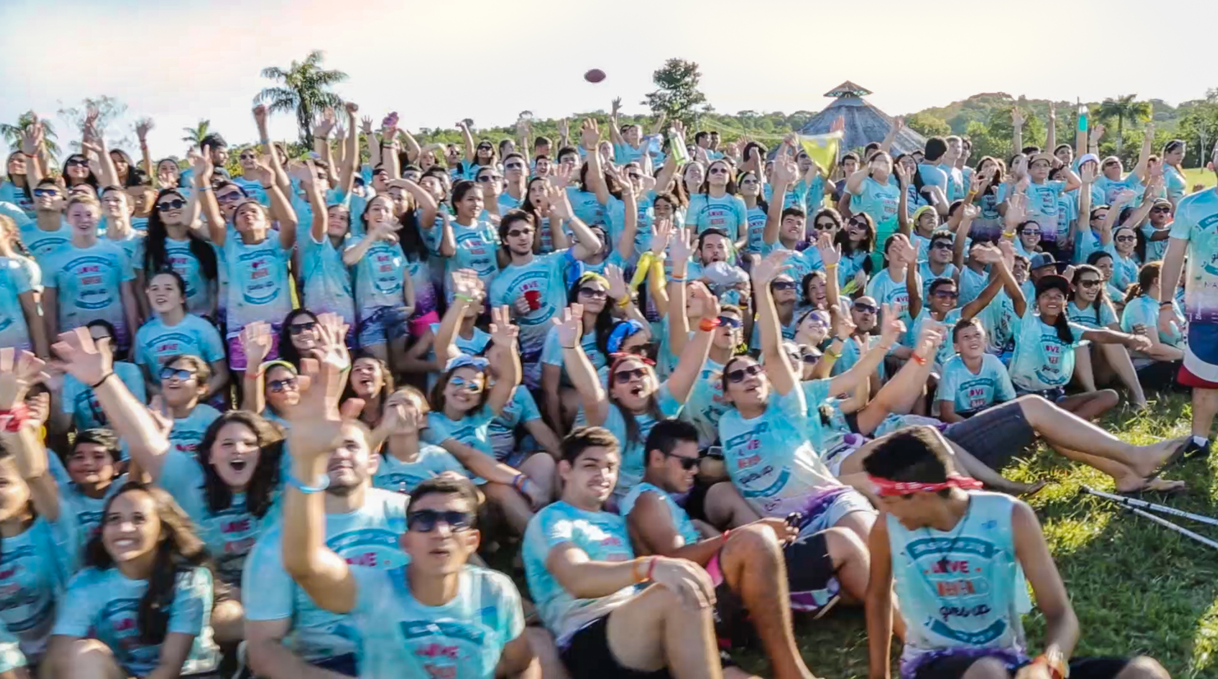 Students cheer as they prepare for the annual camp picture
