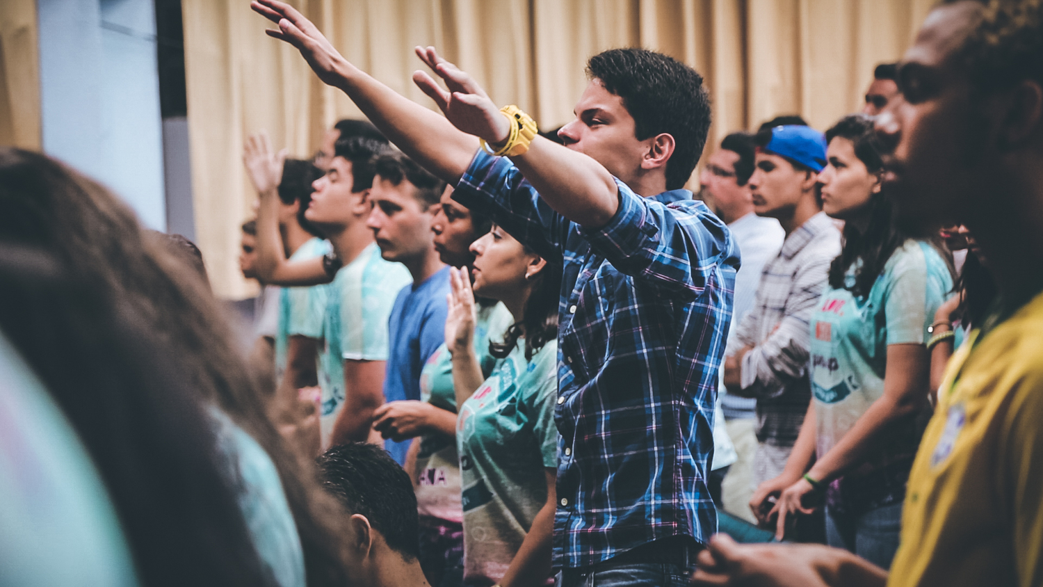 A student worships during our celebration service