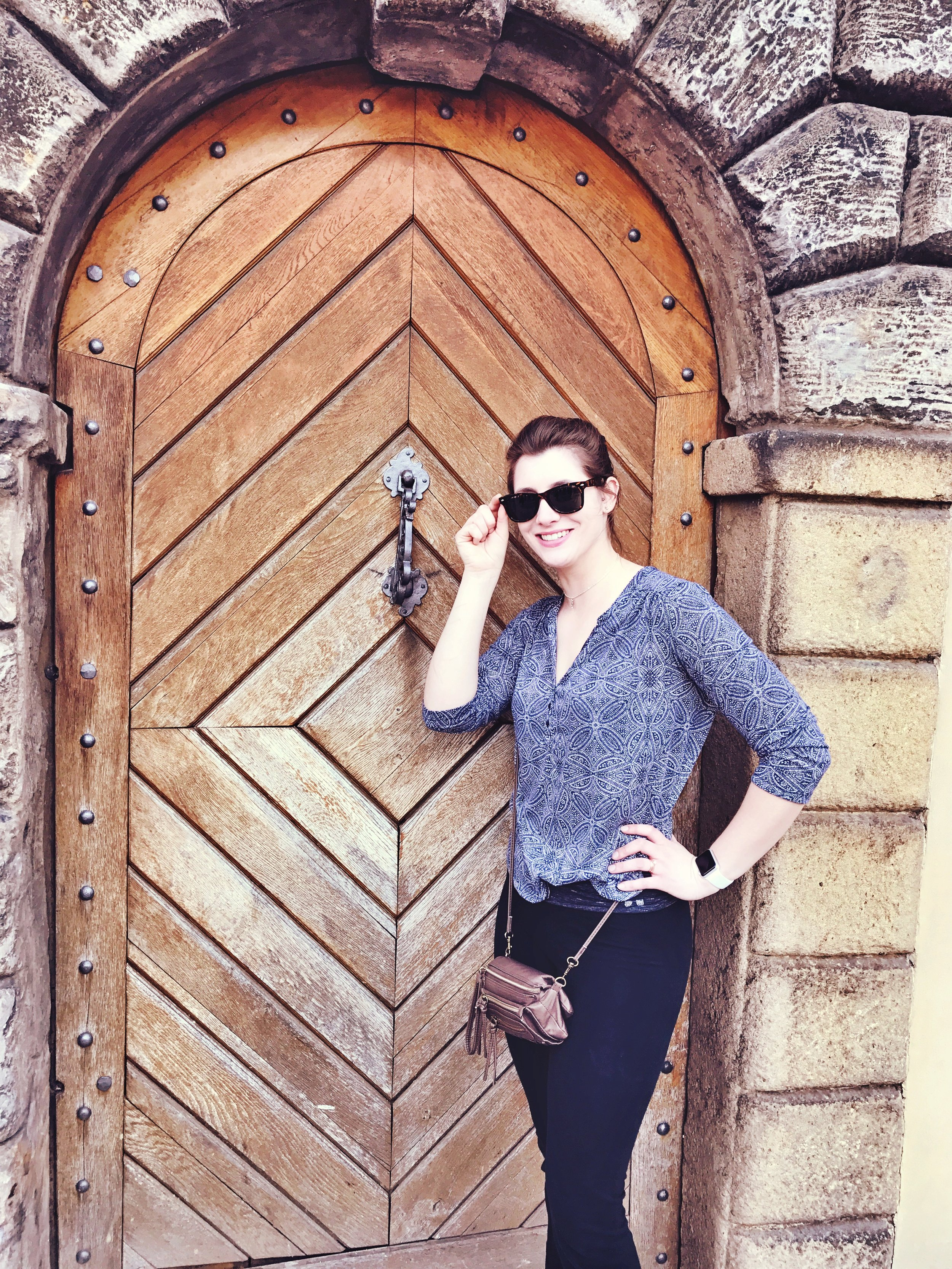 "Bri stunning the passers-by as she poses next to the ""hey look at that cool door"" we found"