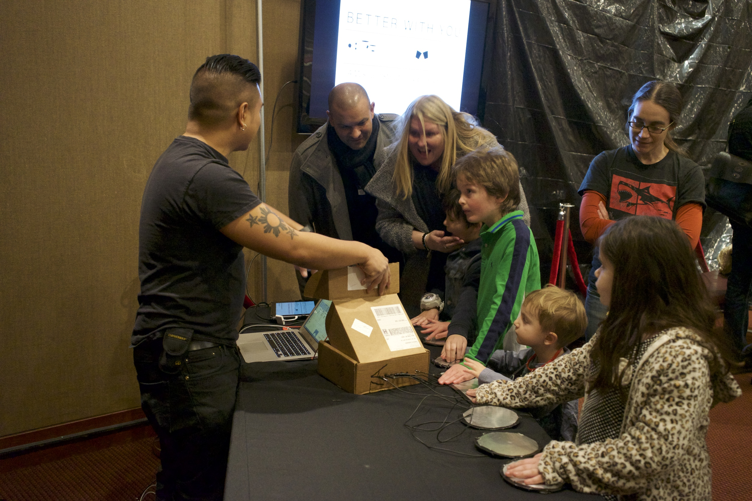 Here I am convincing some parents that the design of the installation is very simple and not run by the Great Old Ones.