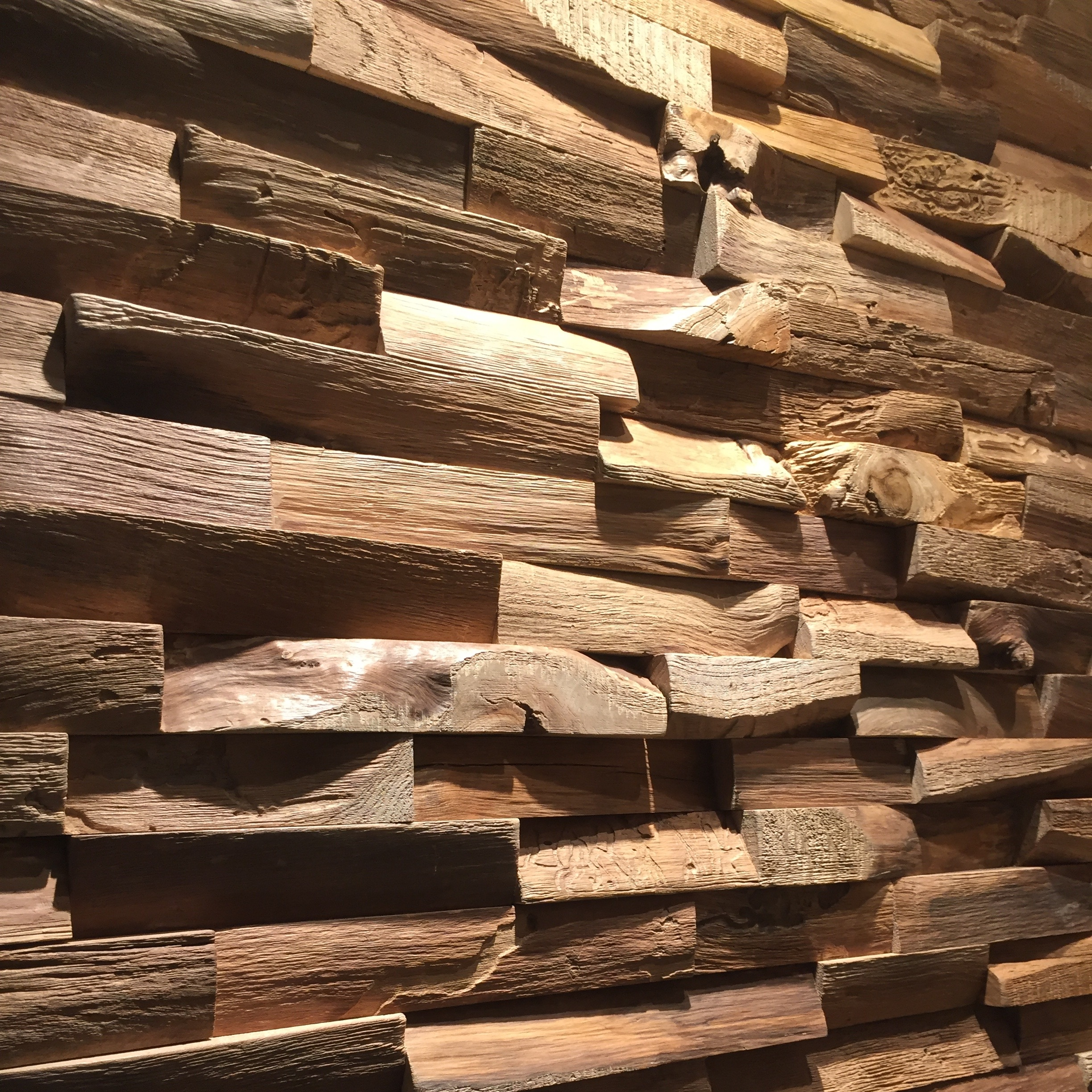 RECYCLED TEAK WOOD WALL PANELS - The waste from rough cut pieces of Teak logs reclaimed and made into beautiful relief wall panels showcase the natural beauty of raw teak.
