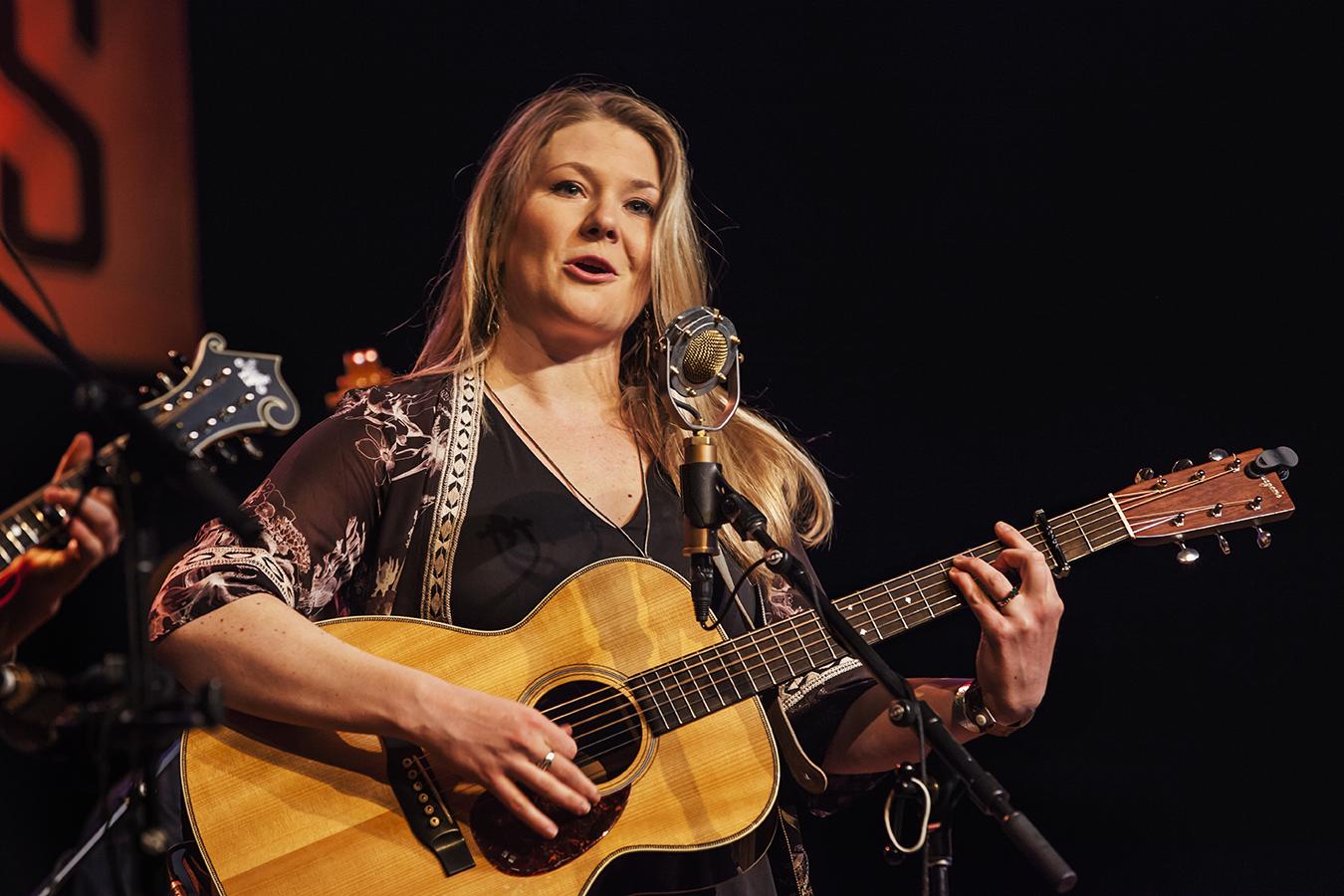 celia woodsmith, lead singer for della mae. photo by hermon joyner.