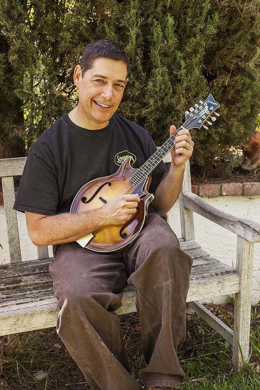 Steve sorensen with a sprite two-point mandolin, Photo by Hermon Joyner.