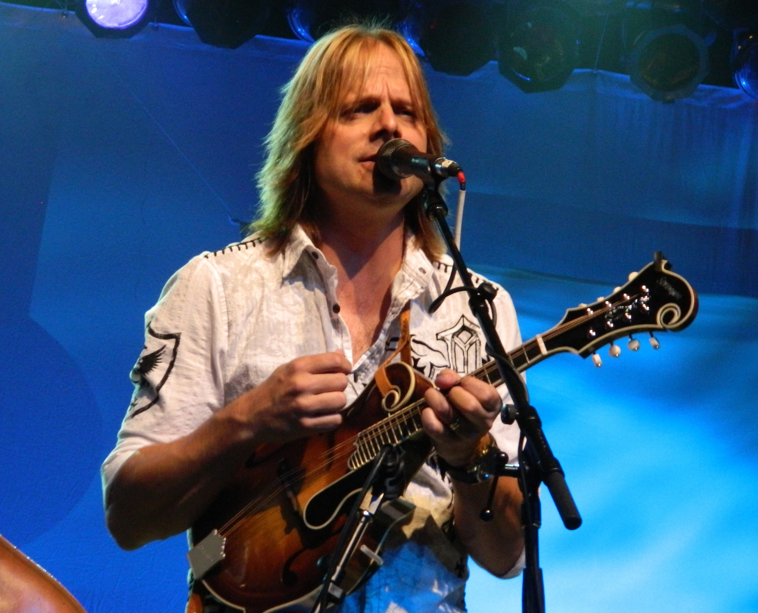 lee roy with his f8 mandolin. photo courtesy of the roys.