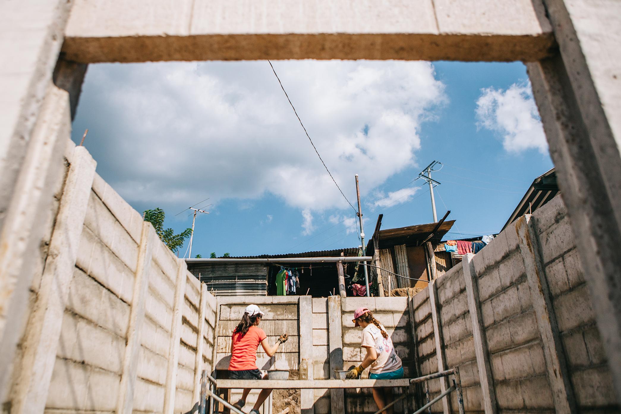 Mortaring a houseat the worksite- Talnique, El Salvador