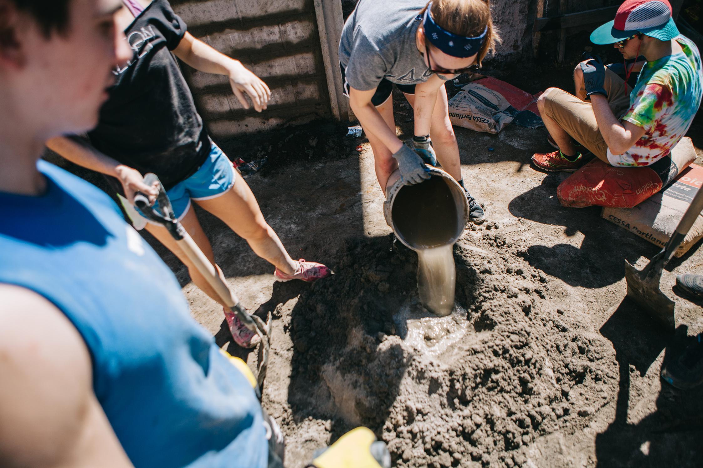 Mixing concrete by hand. Talnique. El Salvador
