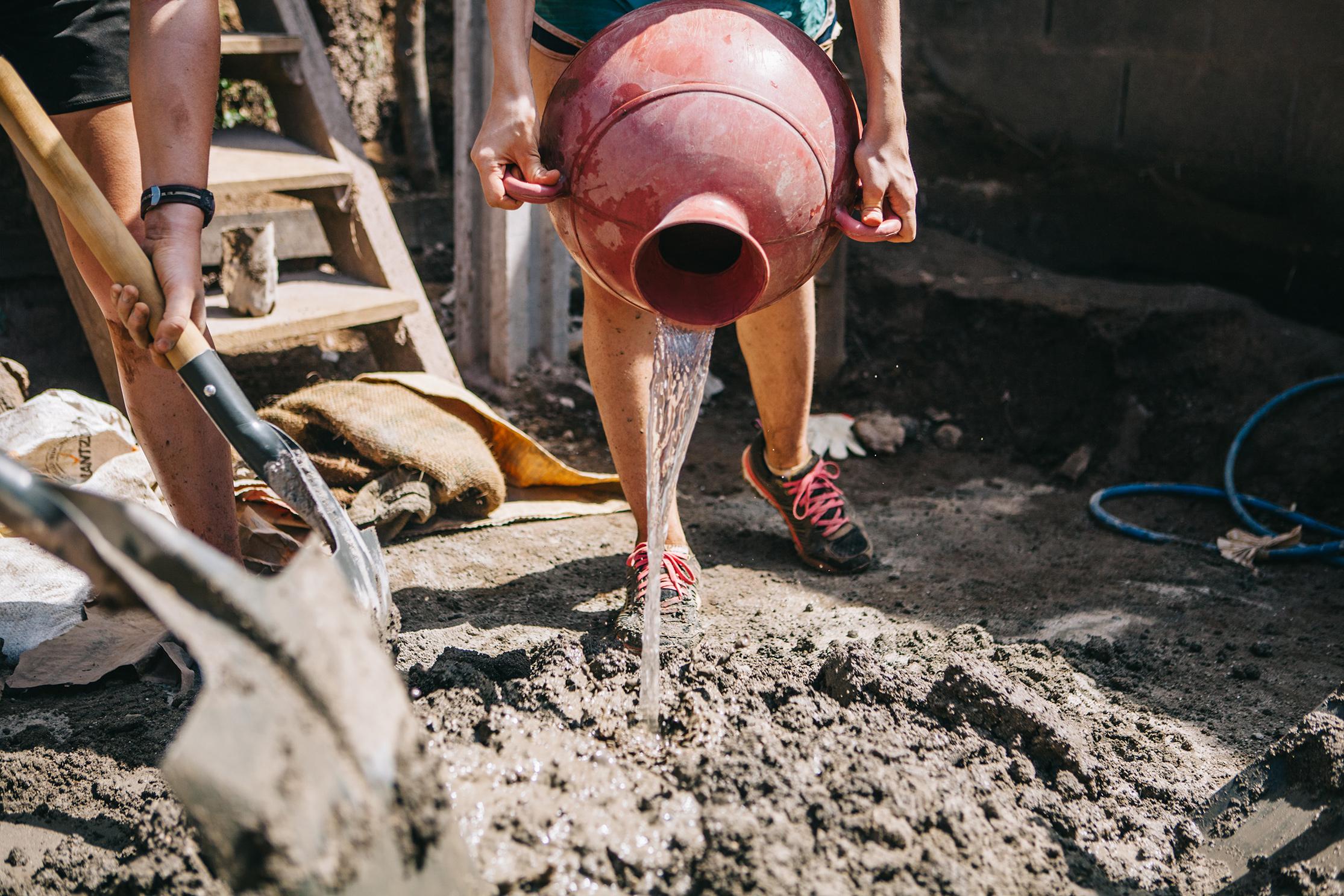Making more concrete and mortar. Talnique, El Salvador