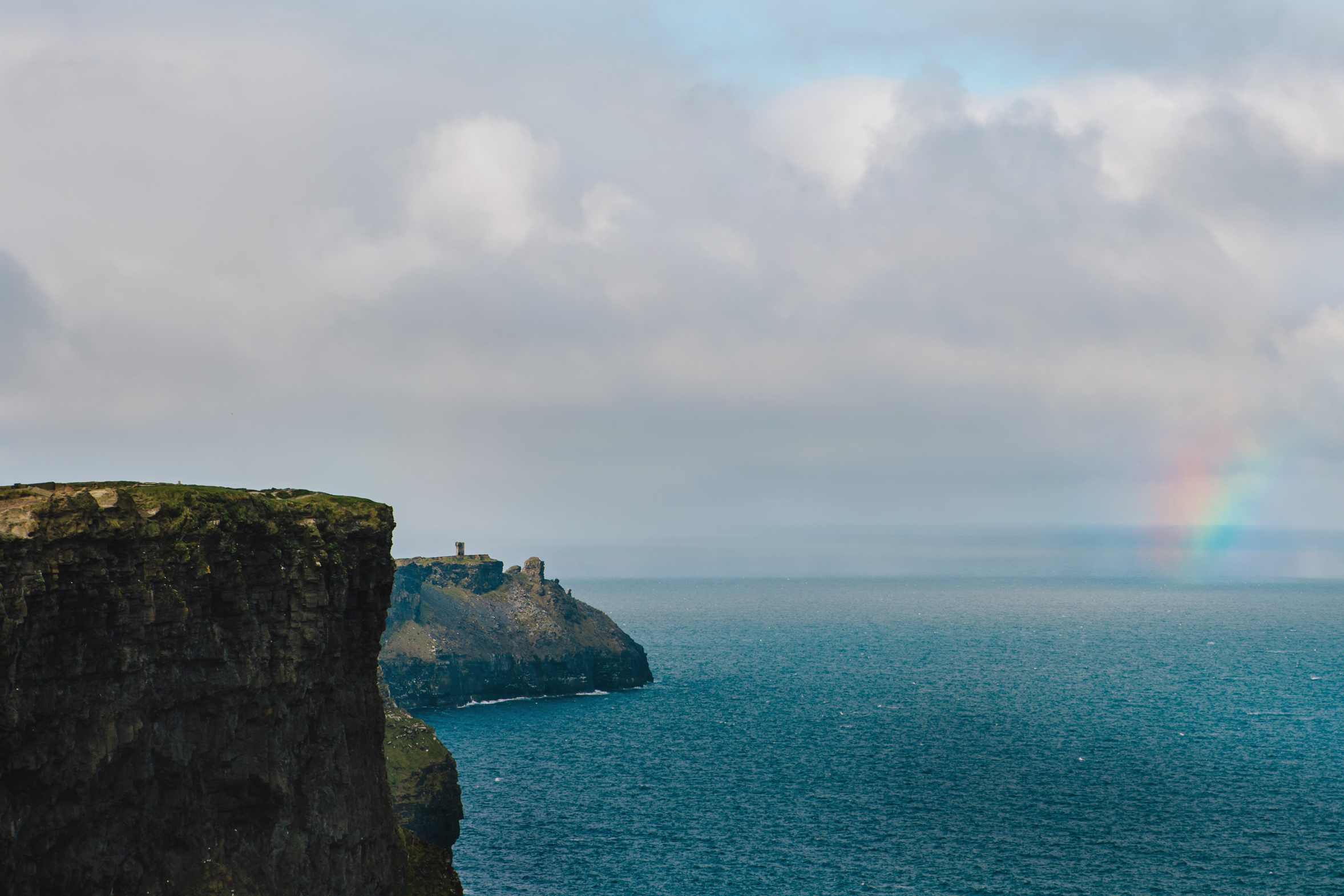 Ireland_CliifsOfMoher_rainbow_rain_travel.jpg