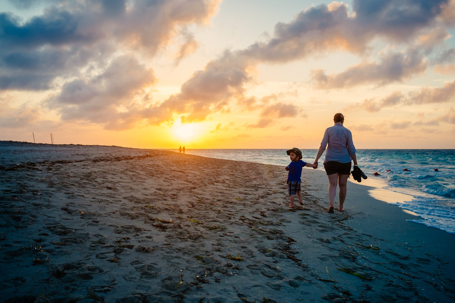 Mother and son enjoying a sunset walk on the beach in Varadero, Cuda 2015.