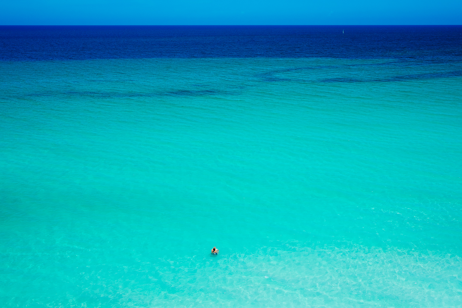 A couple all alone in the ocean in Varadero, Cuba 2015.