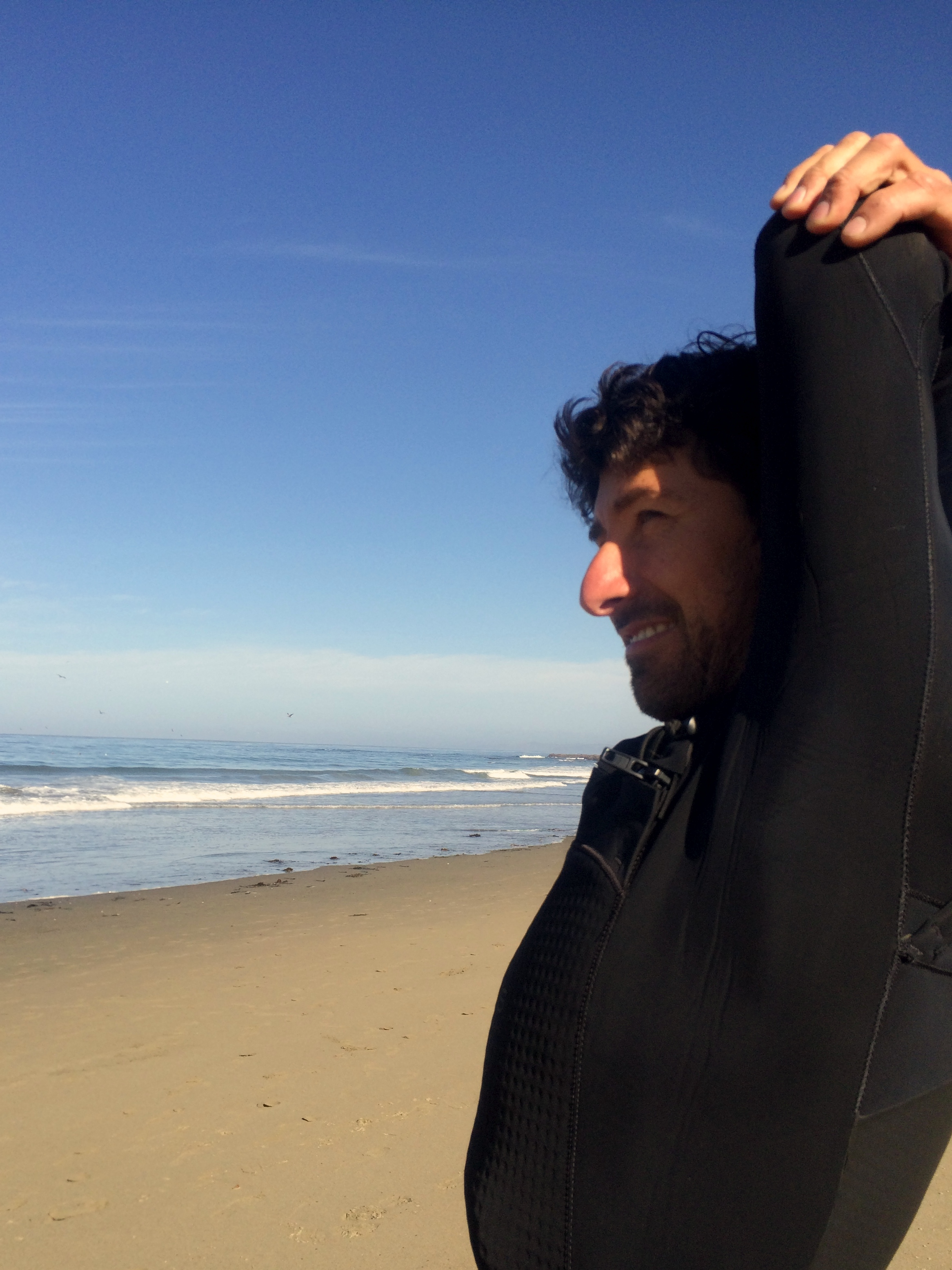I love taking pre-surfing photos--The Check, the wetsuit-donning squirm, sunscreening, stretching. It reminds me a little of Degas's behind-the scenes dancer paintings.