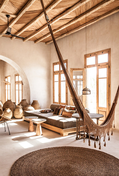 I love everything about this space. The mixture of textures really make this space unique, warm and inviting. The large windows and rustic minimalism of the furniture make you focus more on what is happening in the space rather than the space itself.