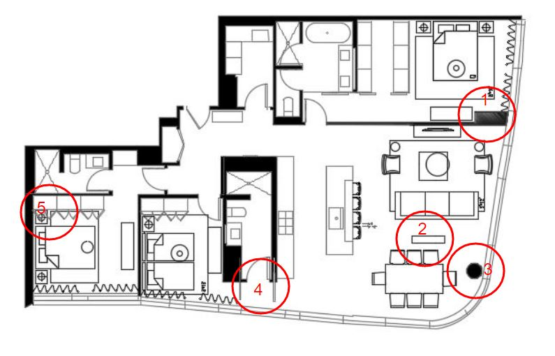 1. I circled this area because in a Master Bedroom such as this, you generally want the furniture centered on each wall. For instance in this room the King Bed is placed on the center of one wall, and the dresser, with a TV is mounted on the opposite wall. This wall seems like a load bearing wall, so it is structural and can not be moved, however, it should have been framed flush with the structural beam so that the wall was flat and the dresser could be place on center with the bed. After all, if you were watching TV in bed, you don't want your head to be turned the entire time, that would be uncomfortable.  2. This is a junction box which is where the dining room lighting was intended to be. But based on the shape of the room, and the location of the cable for the TV, the layout as you see it here is the only way this room will function with the furniture provided. So why is this junction box so far away from where the dining room table is placed? An Architect clearly should have at least asked a designer to place some furniture in the floor plan before building this unit so that these details would have been thought out more.  3. This is another structural column, and though there is not much you can do about this, if this client wanted drapery, there would not be enough space for the drapes to pass between the column and the windows, which would create a light gap, and no one wants that. The only solution here is to do a shade. And I would highly suggest a motorized shade so that the client doesn't have to reach around this column to control the shade.  4. Why so many doors? Why not just one door for the bathroom and one for the bedroom? And how ugly this must look from outside the building, to see a pocket door that doesn't line up with the mullions of the window. Who wants to see the edge of a door frame? No one. Unfortunately this is another example of this design not being thought all the way through from concept to functional completion.  5. This room is a 