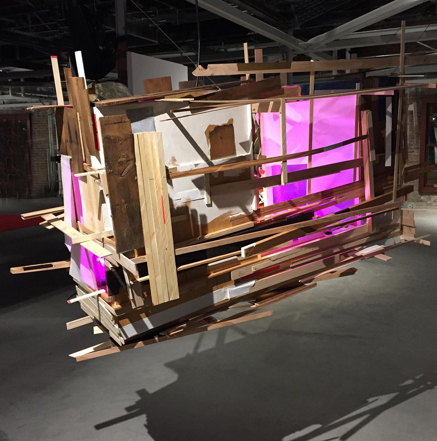 "Bradly Gunn,  Theatrum Orbis Terrarum (Theatre of the World) .Lumber, vellum, paint, tape and fluorescent light,72""L x 29""W x 60""H,2016"