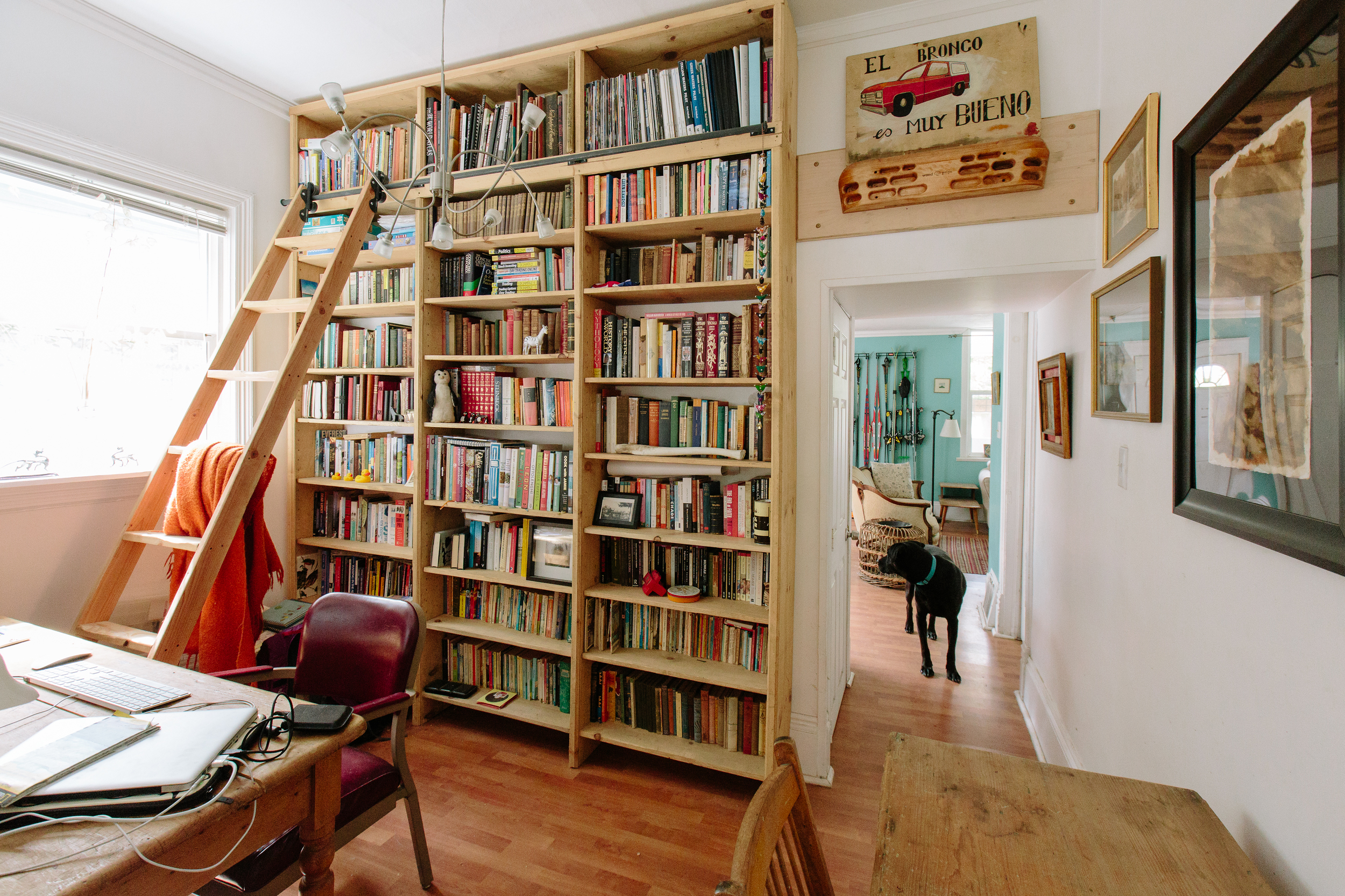 Hannah's library was custom-built by a friend and talented woodworker who happens to live just down the street. I think we can all agree that the best part is the sliding ladder.