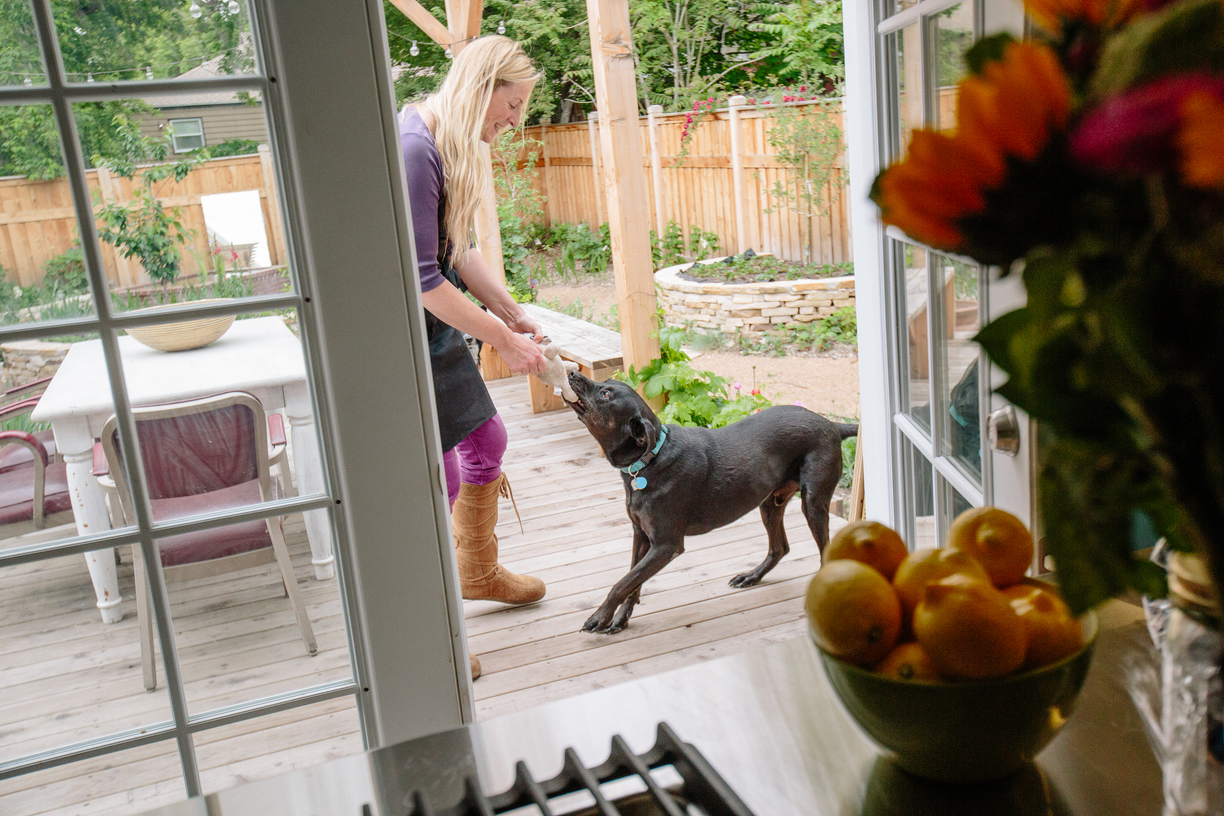 Just off the kitchen is the back deck, and beyond that, the garden.