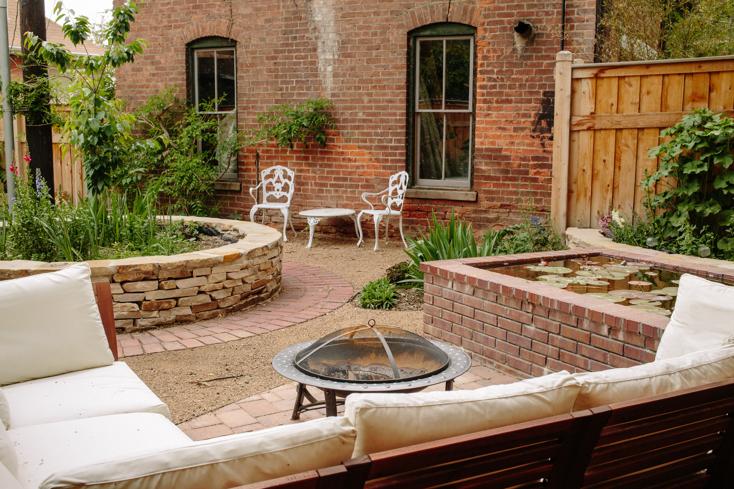 Hannah's backyard is a welcoming mix of English garden and fireside seating.