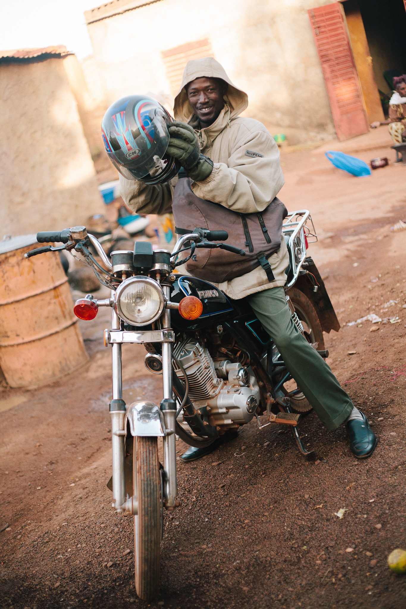 A middle school teacher for the village of Tamala prepares to make the daily commute.
