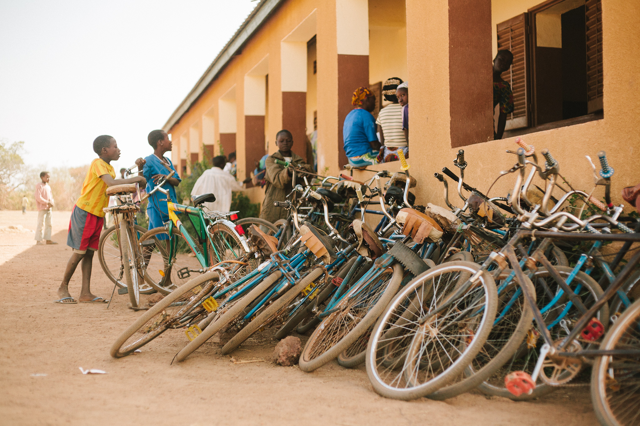 Mali Rising stays in active contact with the communities in which it has helped build schools, and tracks yearly enrollments. Schools constructed in one locale often serve neighboring villages as well, as evidenced by the stack of bikes outside Tamala's middle school, built in 2007.