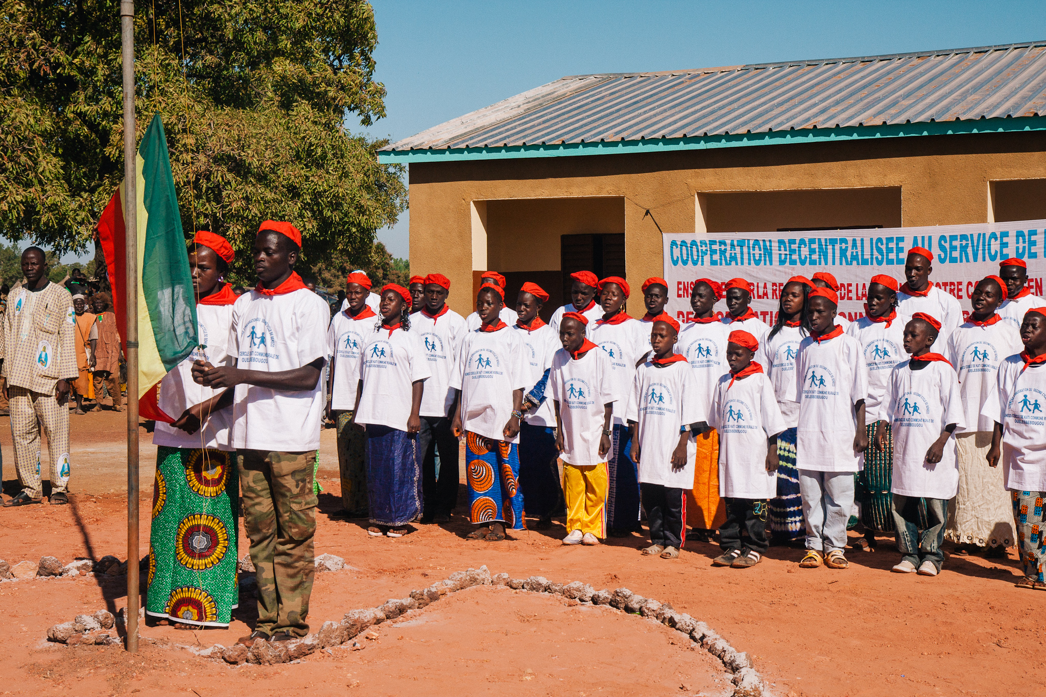 During their school dedication ceremony, Beneko students raise the Malian flag while singing the national anthem.