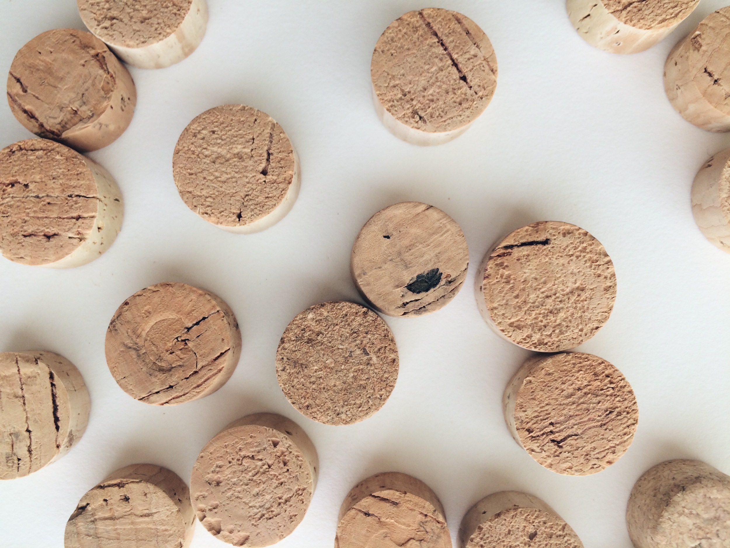 """The """"hooks"""" are slices of recycled cork, which are lightweight and easy to embed magnet into (and thereby making my wine drinking habit finally come in handy)."""