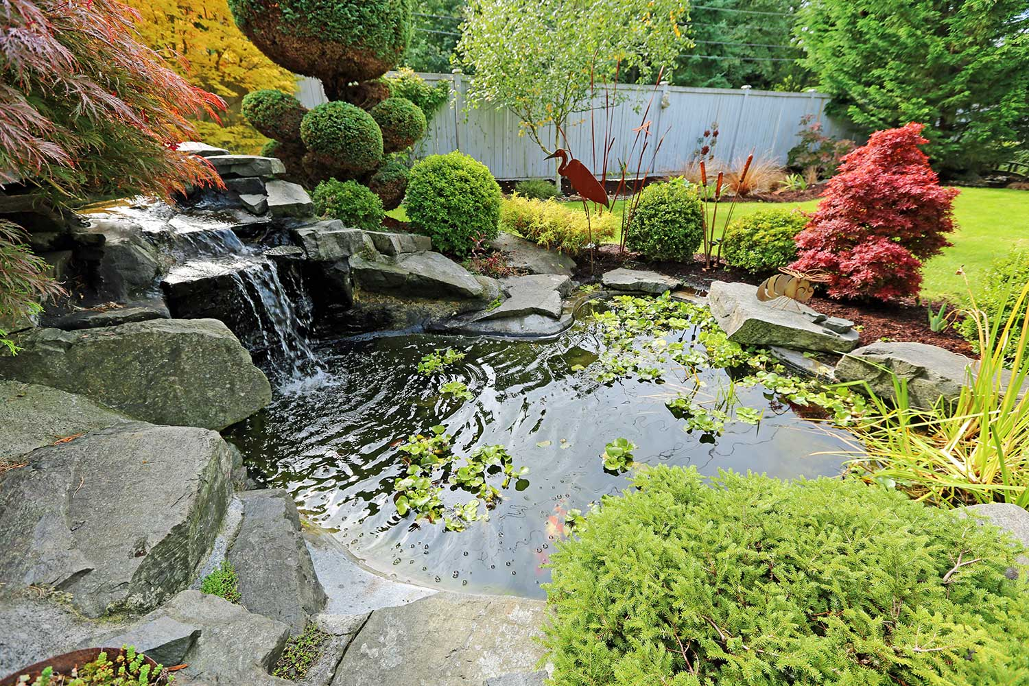 Water Feature Design - Custom Water Feature Design & Installation Including: Backyard Waterfalls, Ponds & Streams. Hillside Landscaping Has Designed Hundreds Of Custom Water Features.