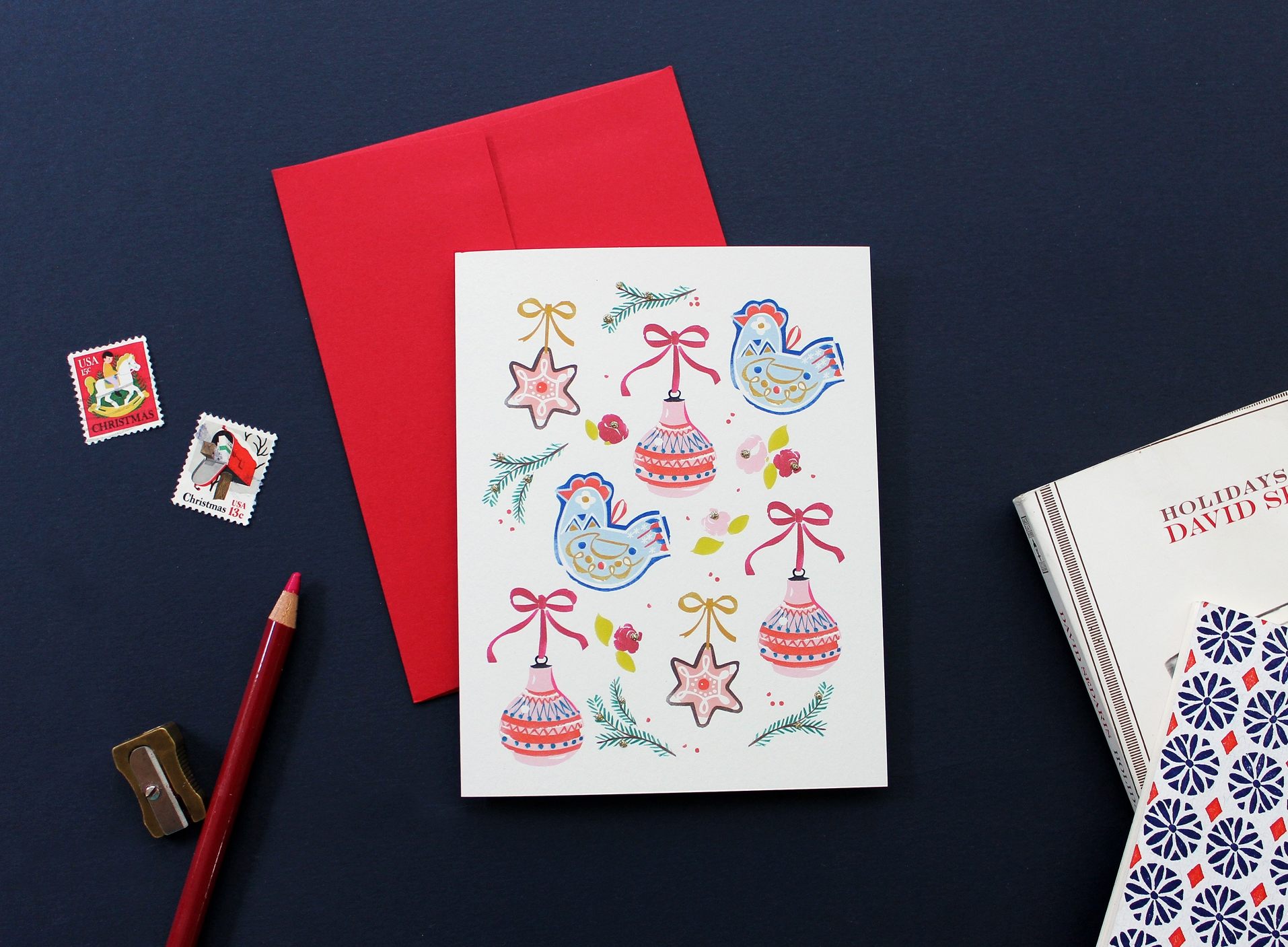 Driscoll Design's beautiful  P320 Folk Ornaments Card  embellished with gold glitter.