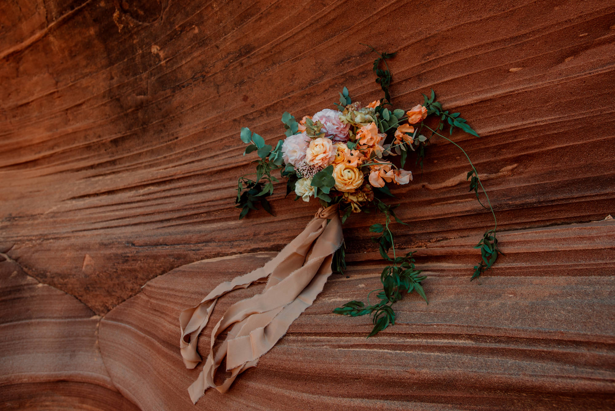 This gorgeous desert bridal bouquet features peach tones.