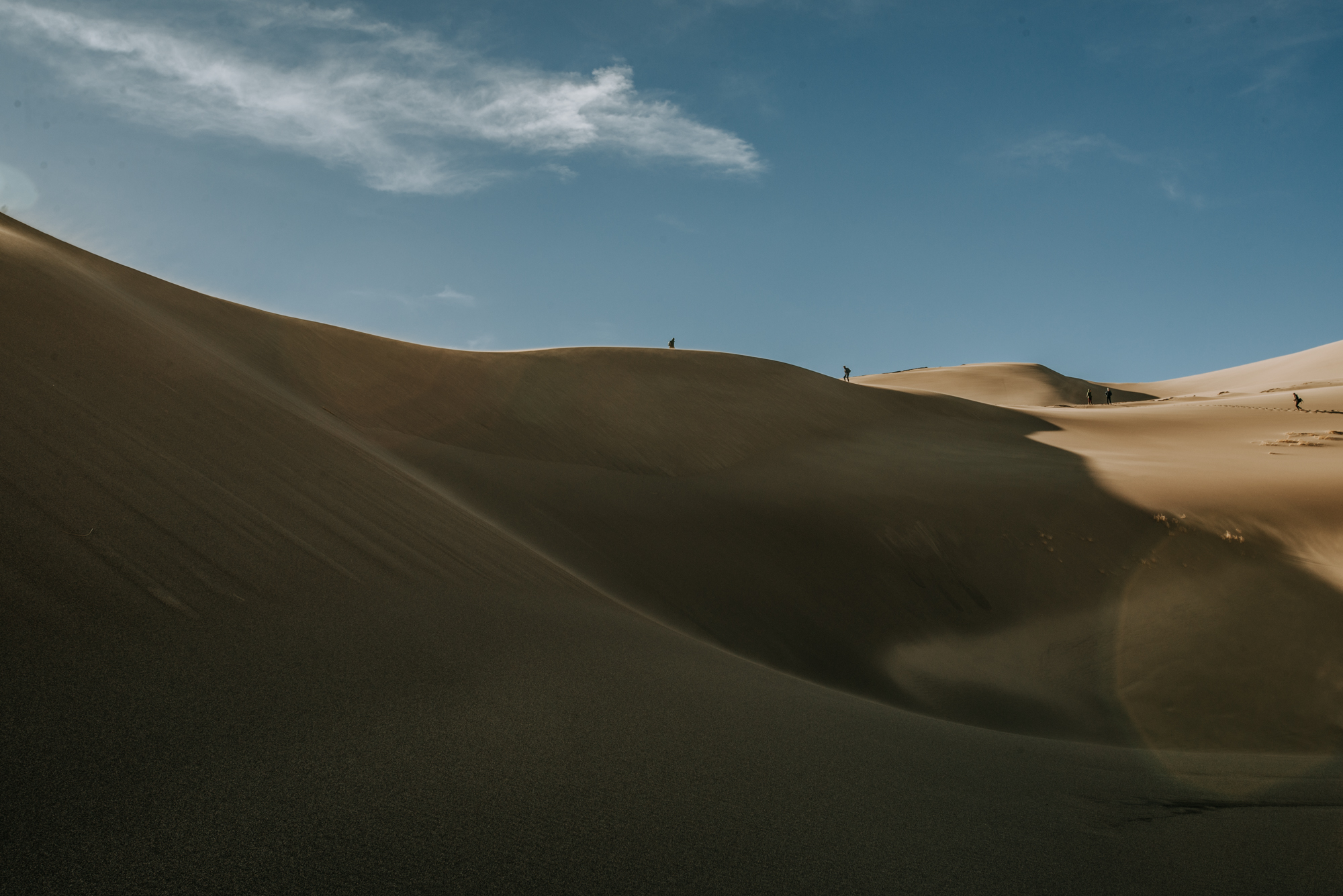 Photographers scale the huge sand dunes at Great Sand Dunes National Park.