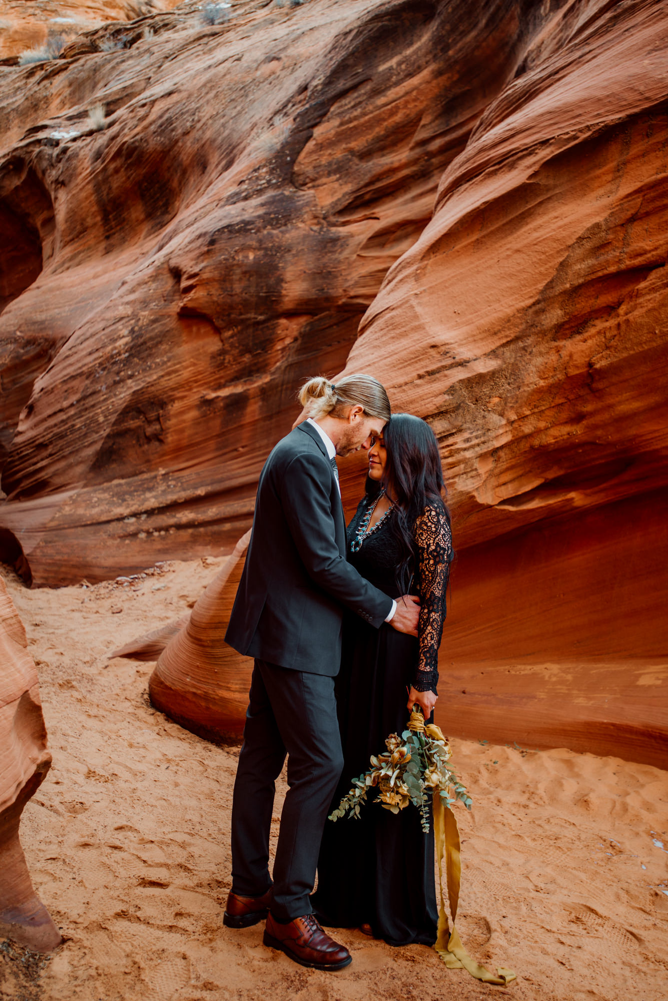Shio and Ron share a quiet moment in the slot canyons.jpg