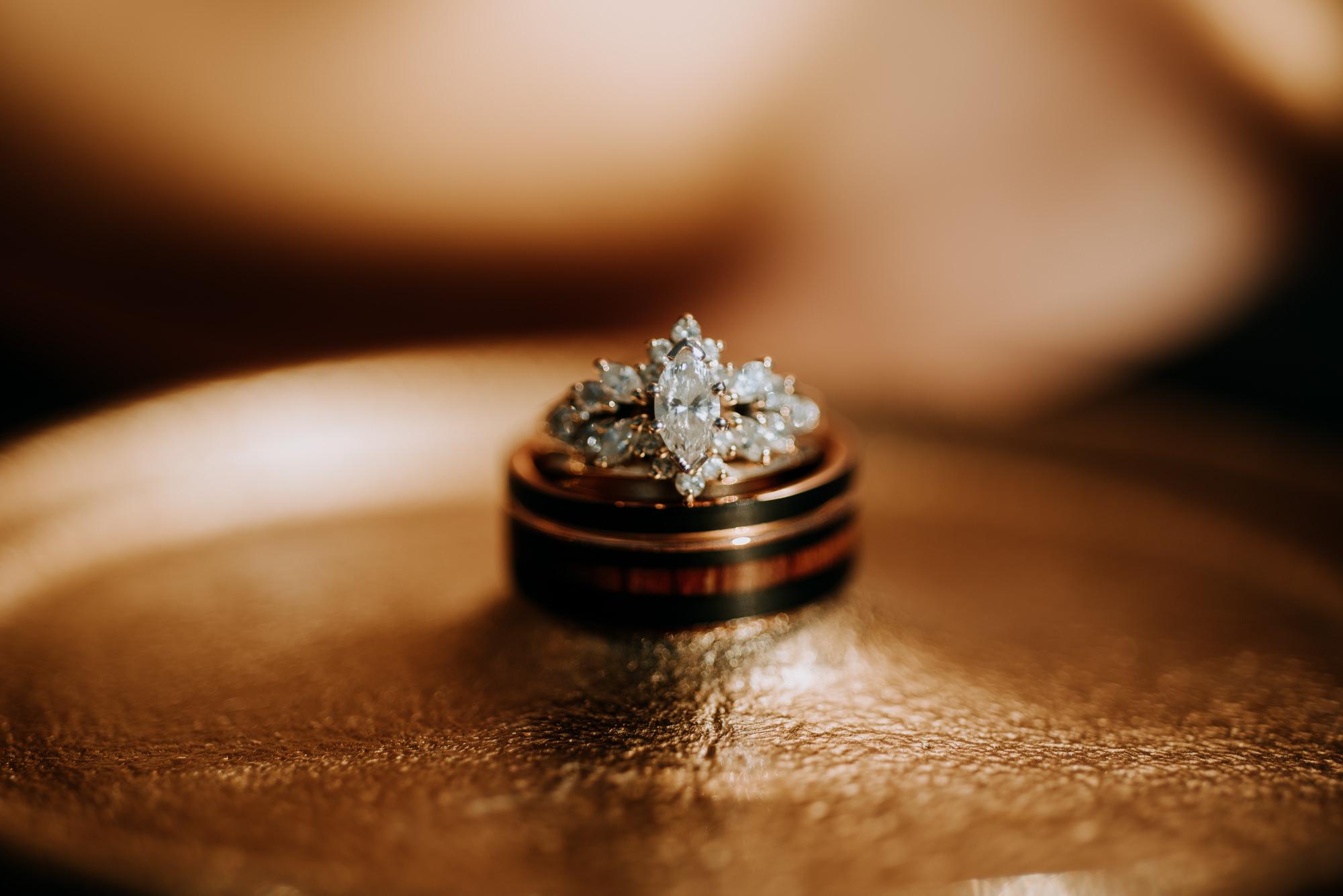 A rose gold and diamond wedding band detail shot.