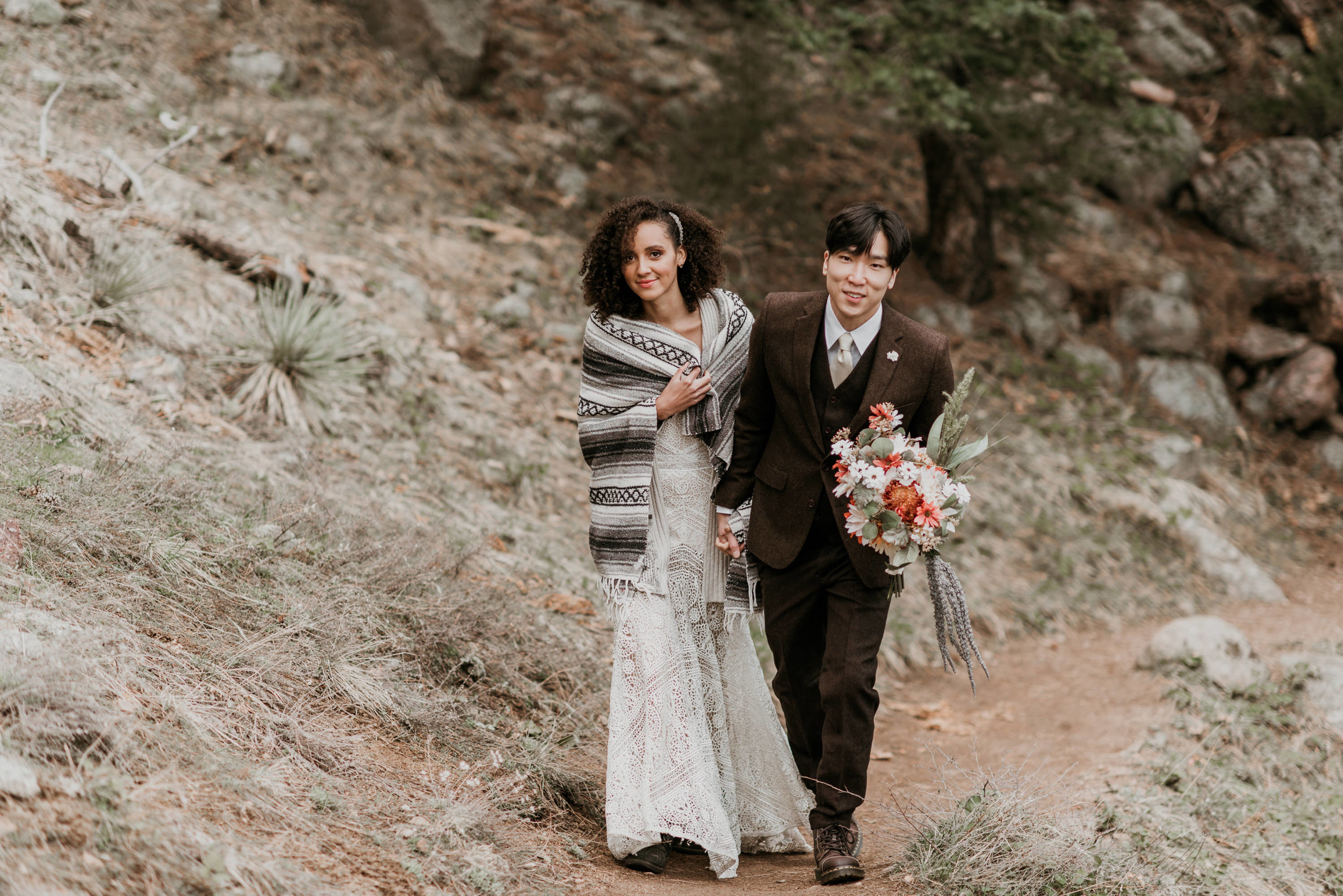 Daniel smiles at the camera as they hike to the wedding spot.