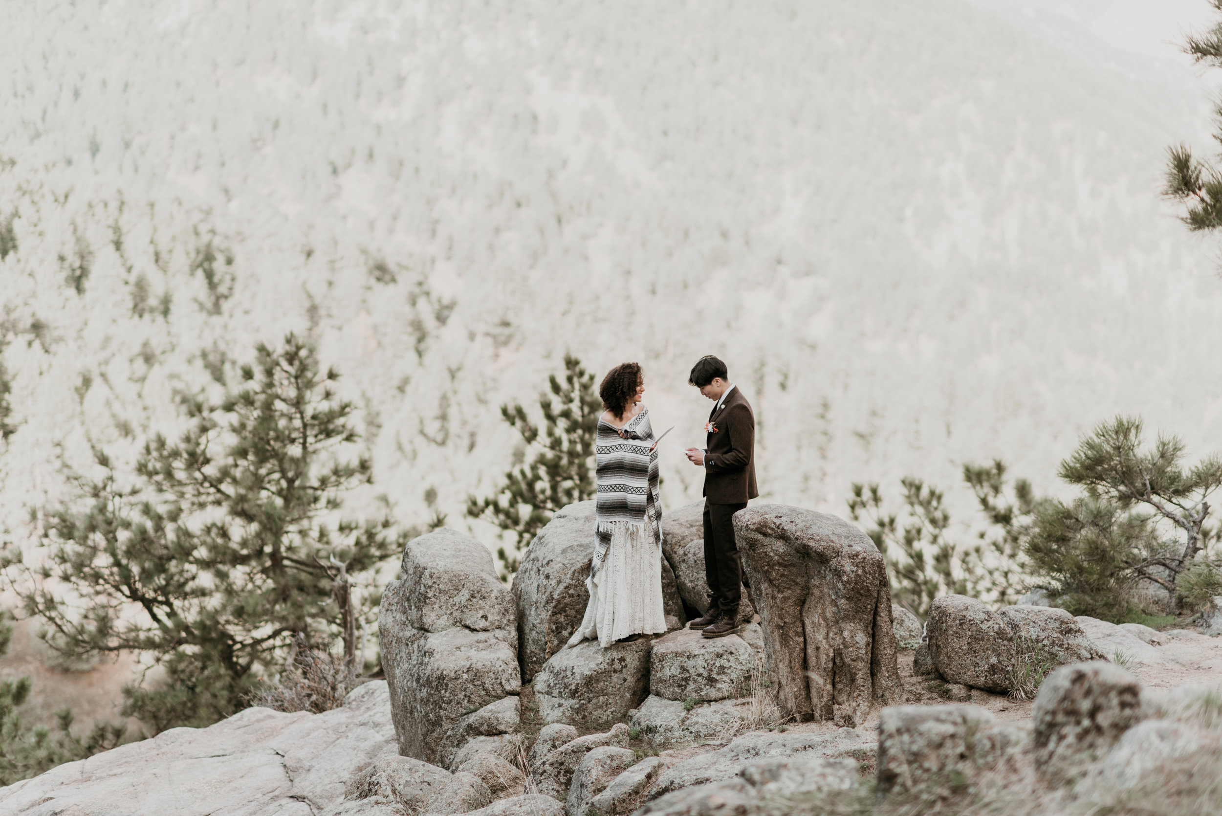 The couple exchanges vows on a sunrise overlook in Boulder, Colorado.
