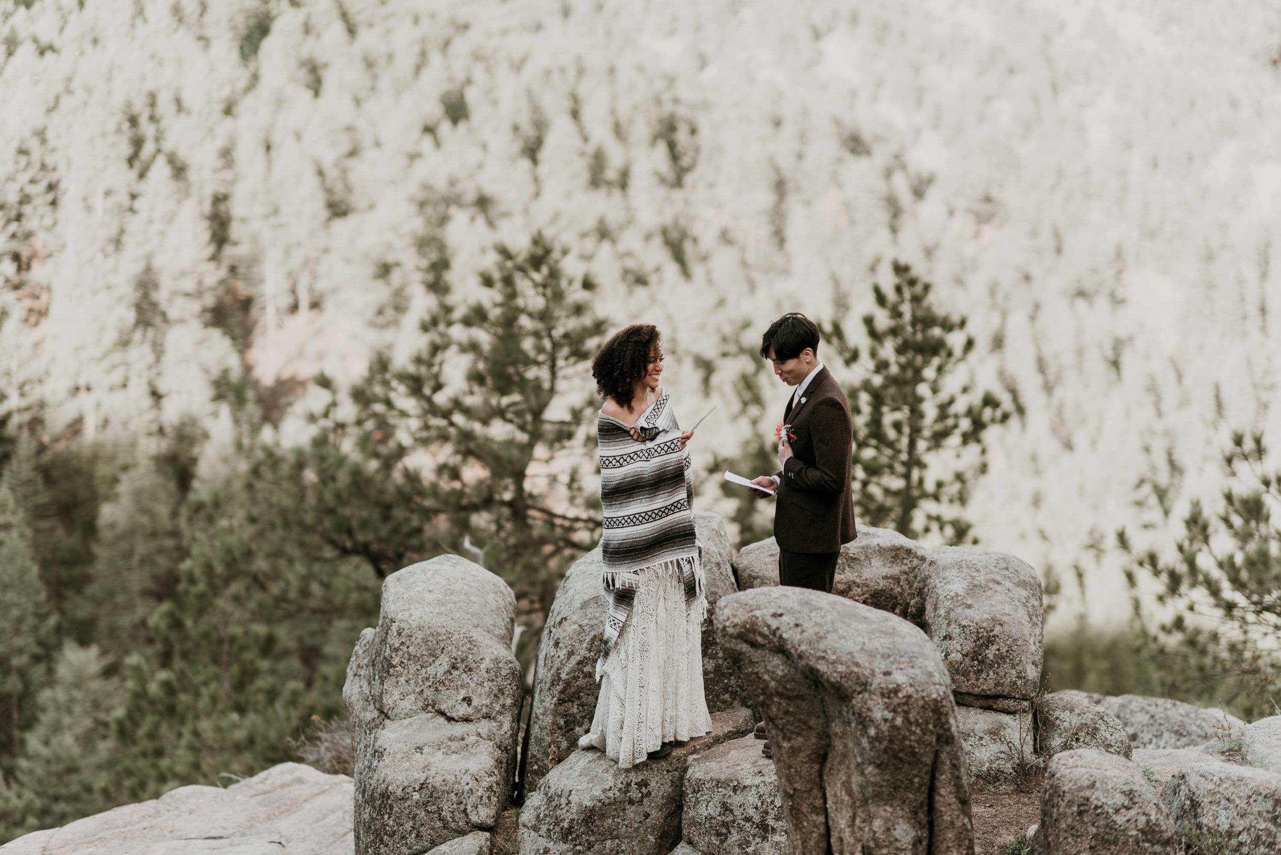 Reading vows during a colorado mountain elopement.