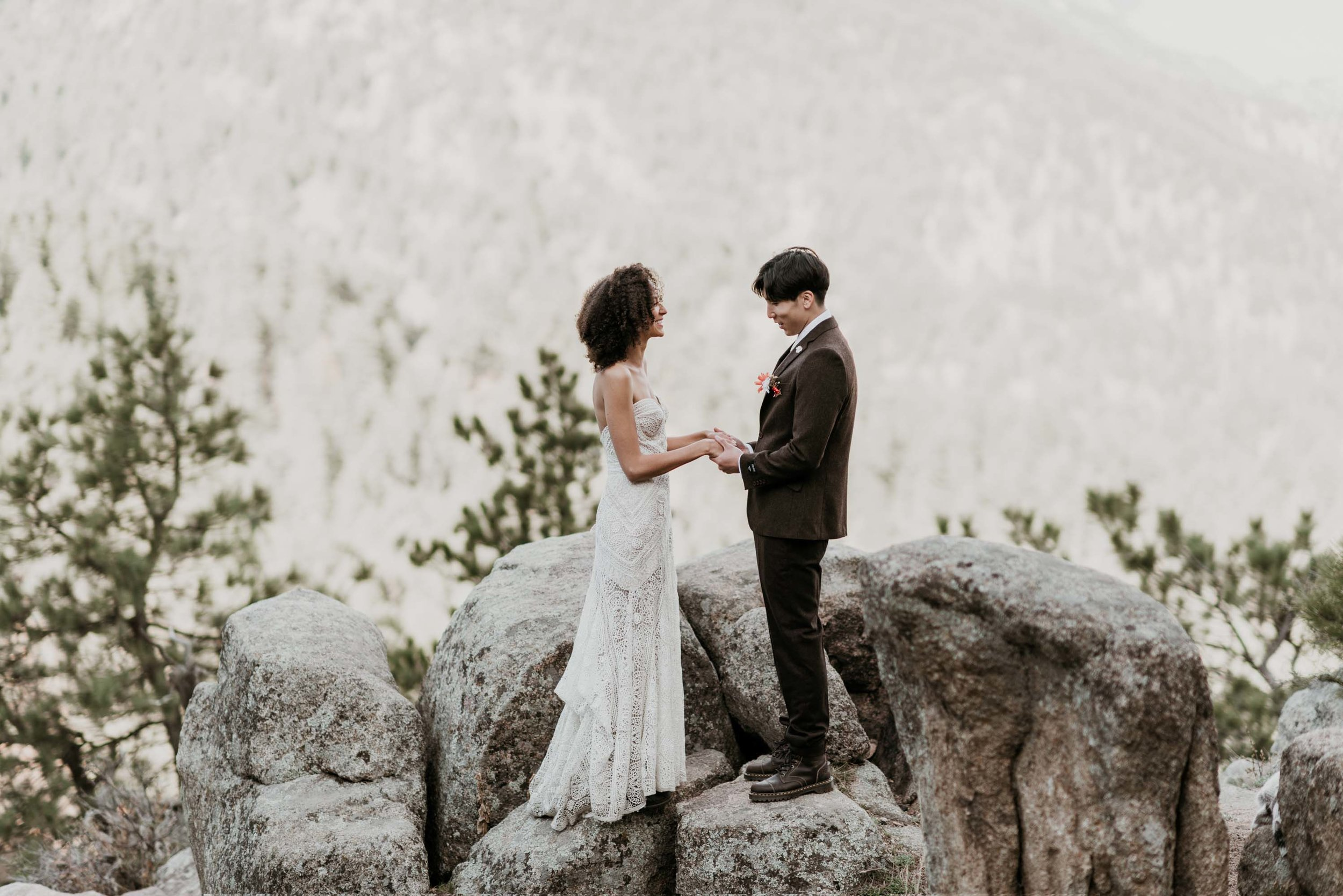 A simple wedding ceremony in the Colorado foothills. The bride wears rue de seine and the groom is in a dark wool tweed.