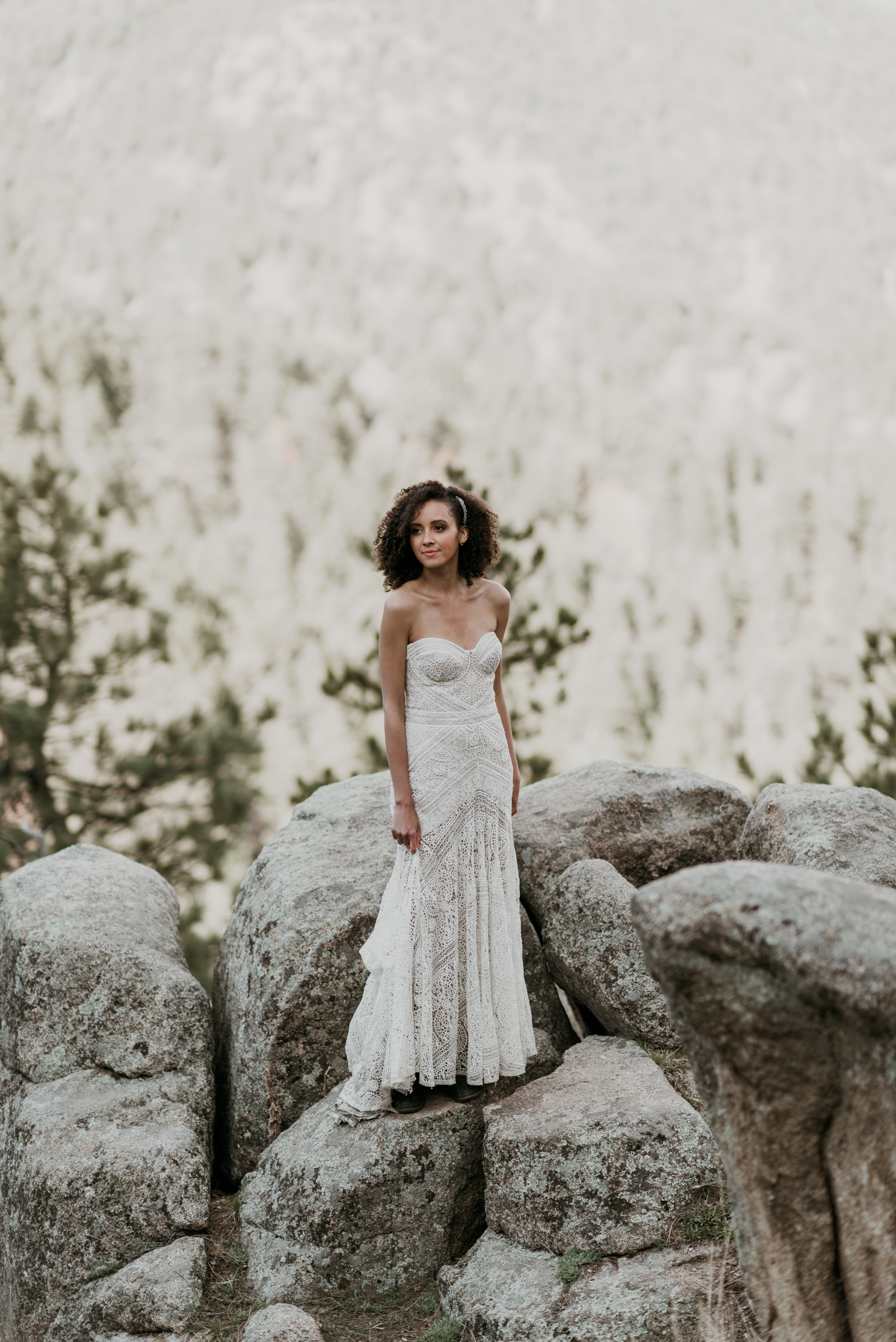 The bride wears a GORGEOUS hand made lace gown from New Zealand.