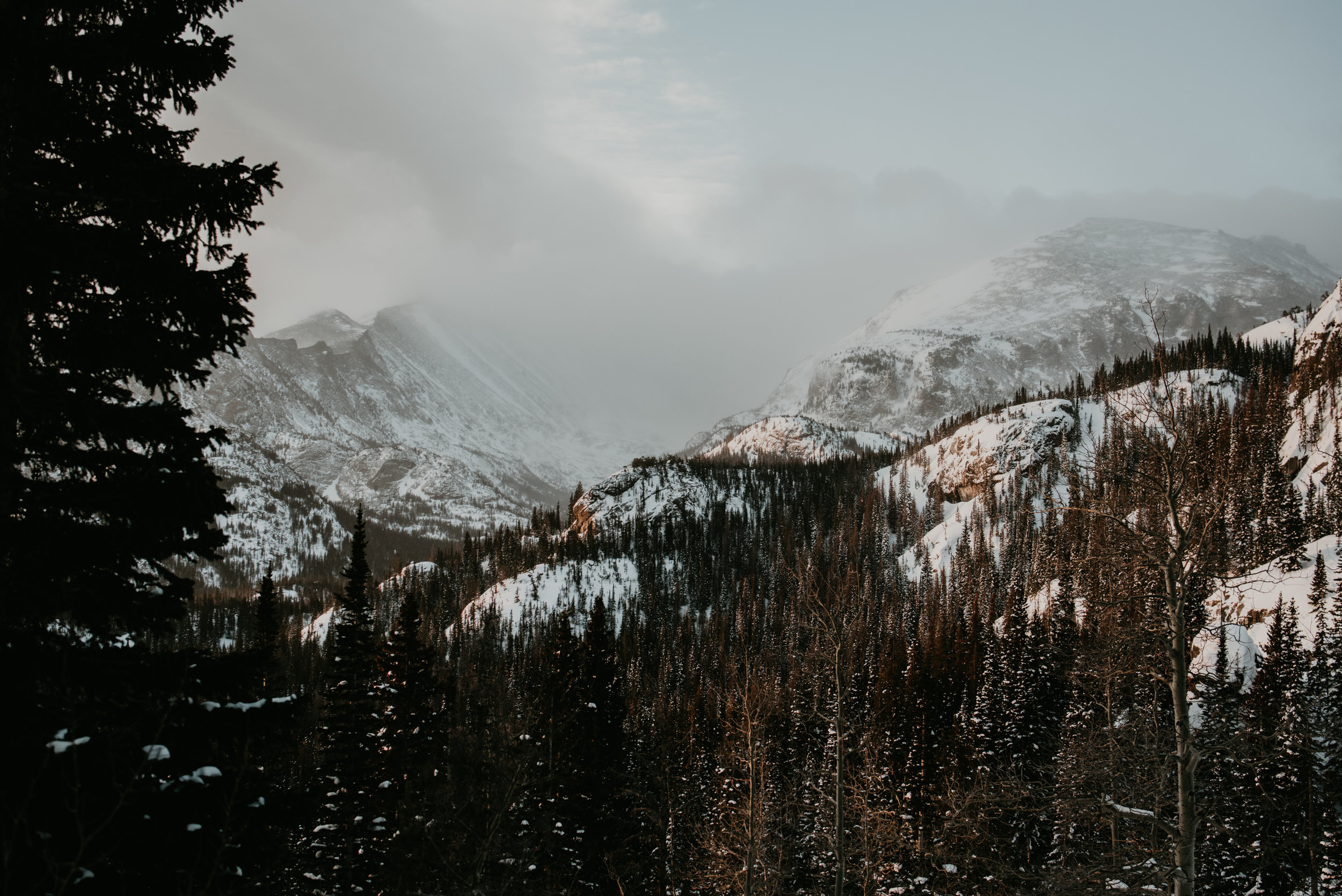 Snowy view of Rocky Mountain National Park in Spring.