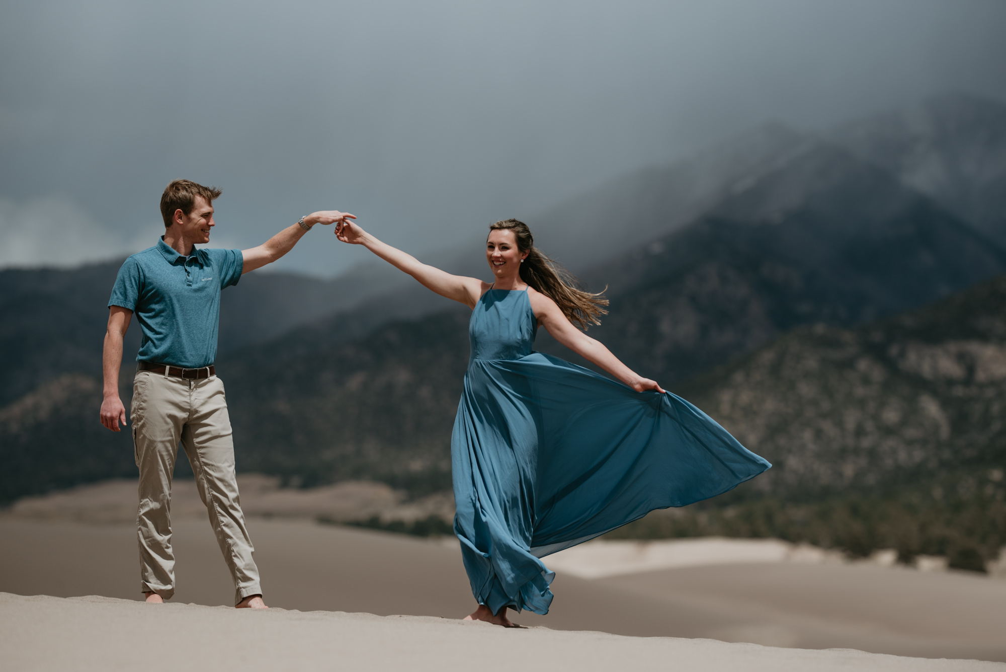 Brittany and Eric dancing at the dunes