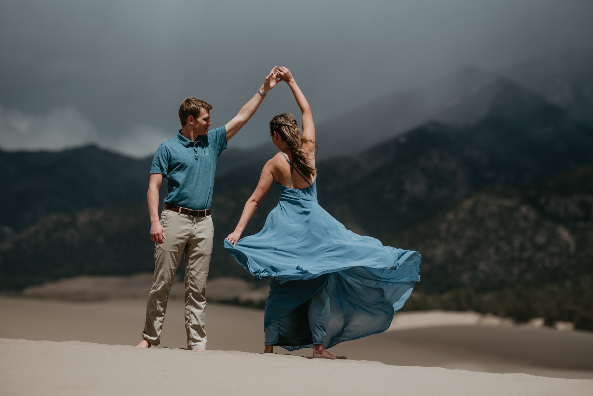 Brittany's blue dress twirls in the wind.