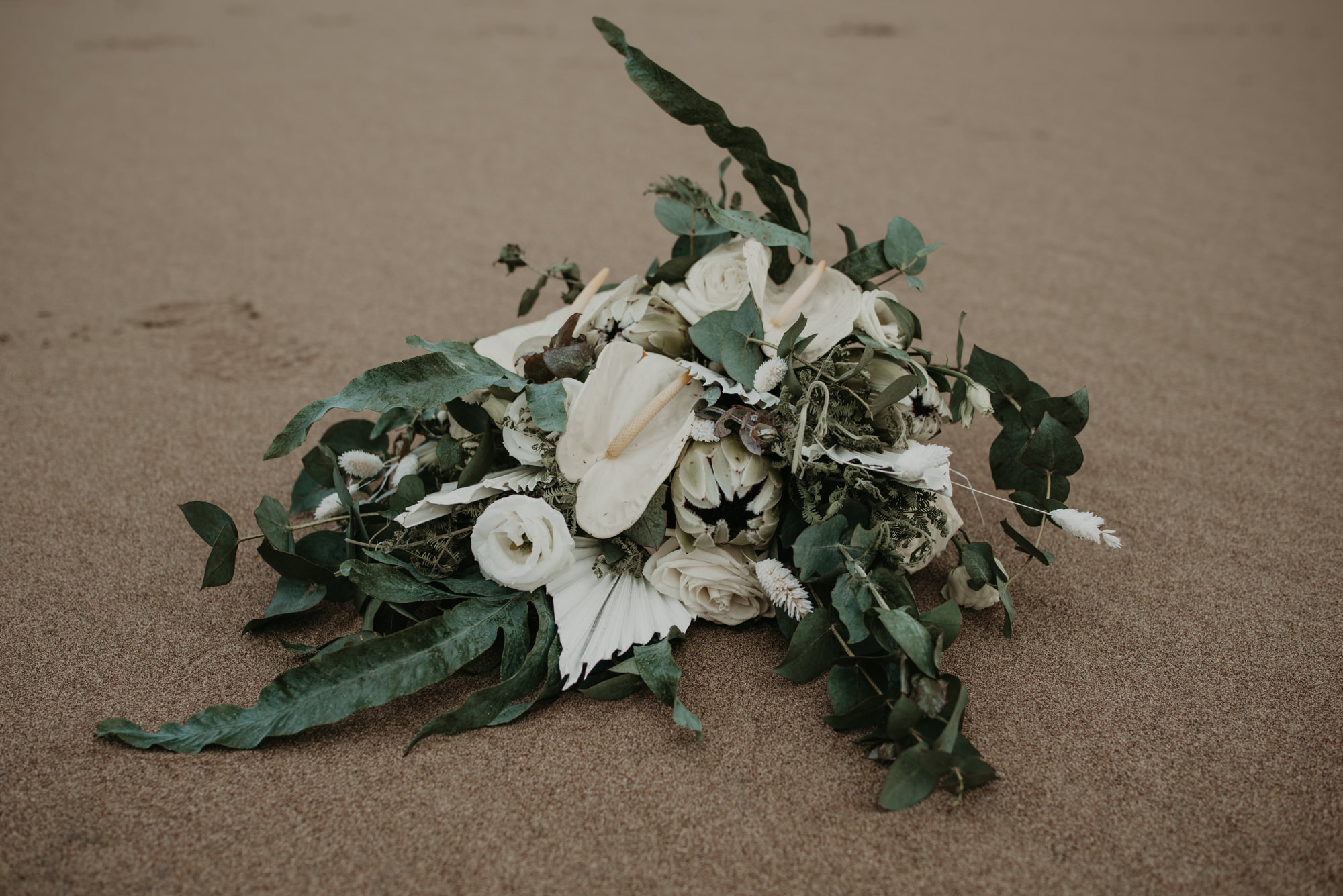 I love this bouquet against the sand.