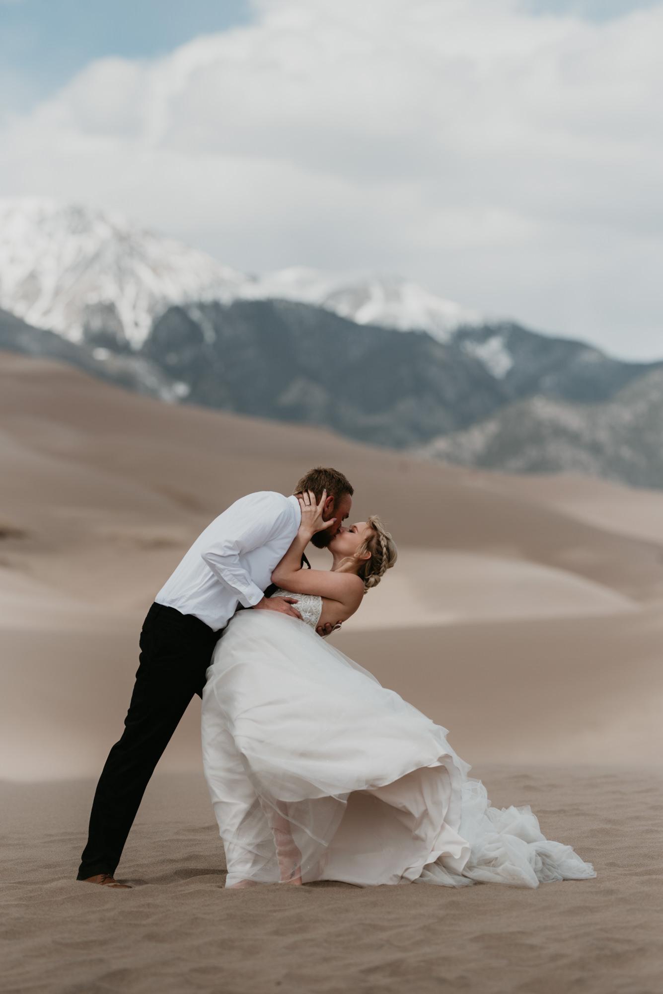 Doug dips Kaitlin in front of the Sangre de Cristo Mountains.