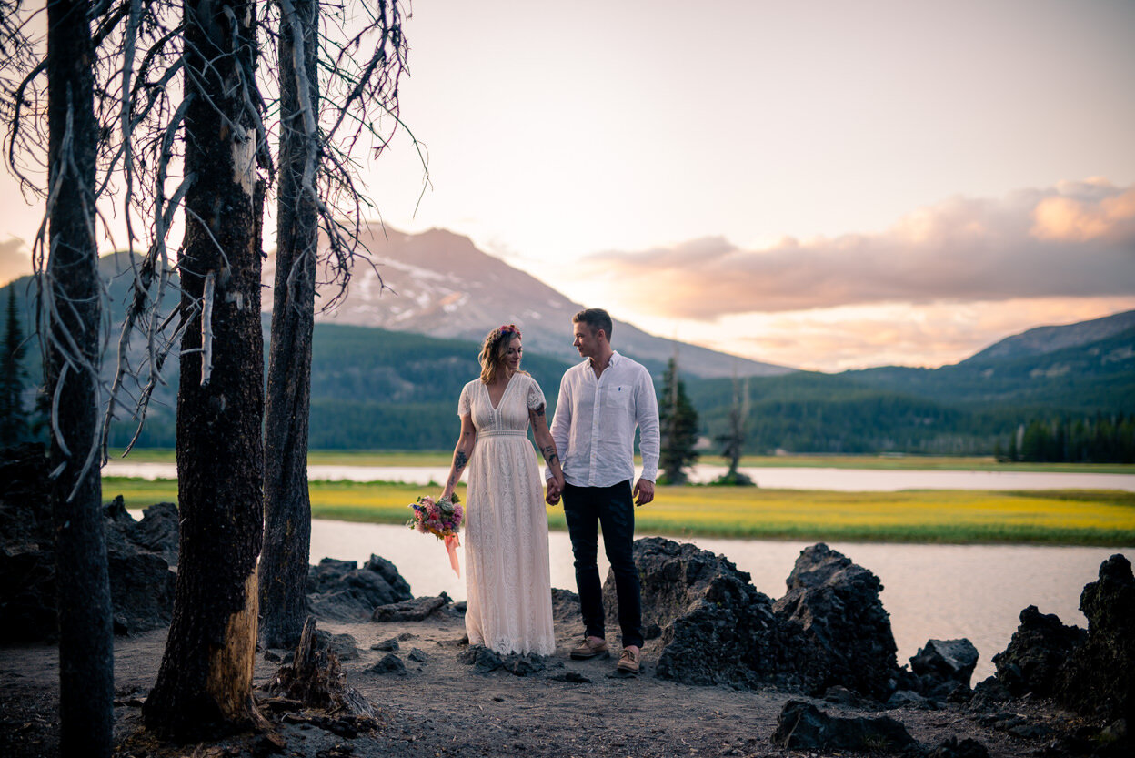 A couple holds hands during sunset in central Oregon.