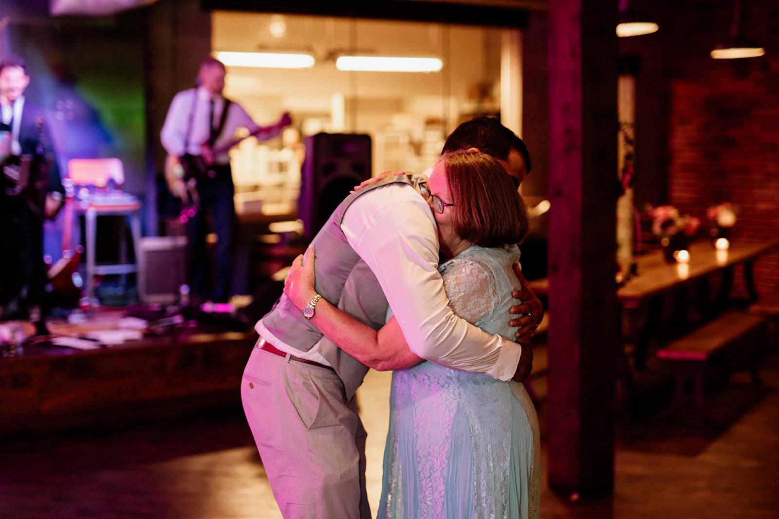 Mother son dance during an elopement reception.