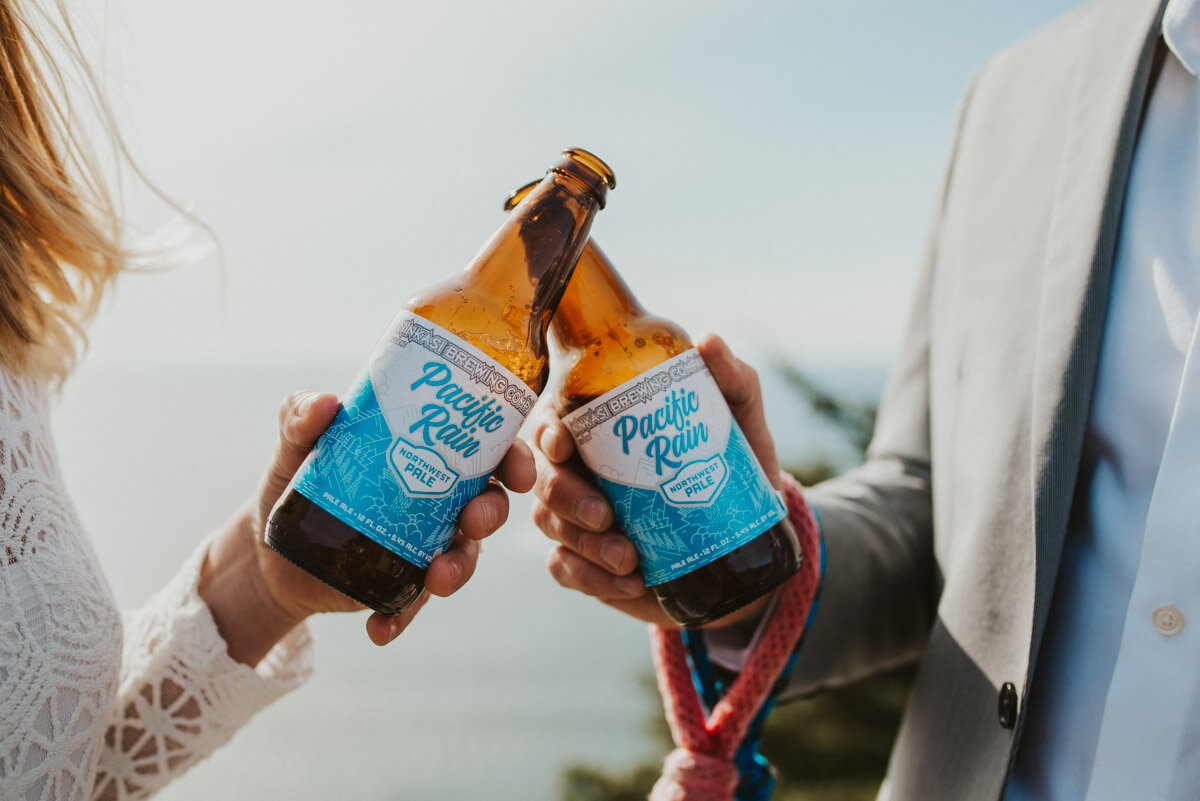 A couple toasts with Ninkasi beer on their wedding day.