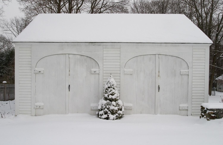 white garage covered in snow.jpg