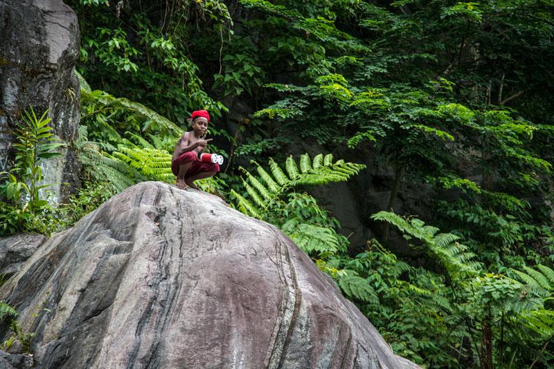 kid-with-boombox-waterfal-Sentani-Papua-Indonesia-Naomi-VanDoren.jpg